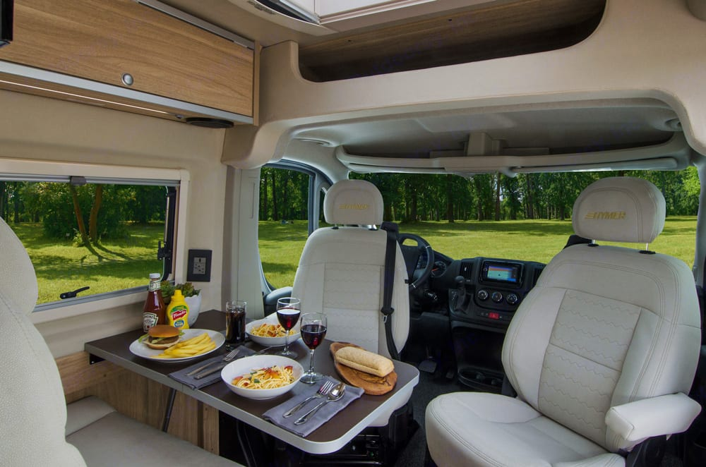 Front cab swivel chairs to create a dining/office space.. Dodge ProMaster Ram 2018