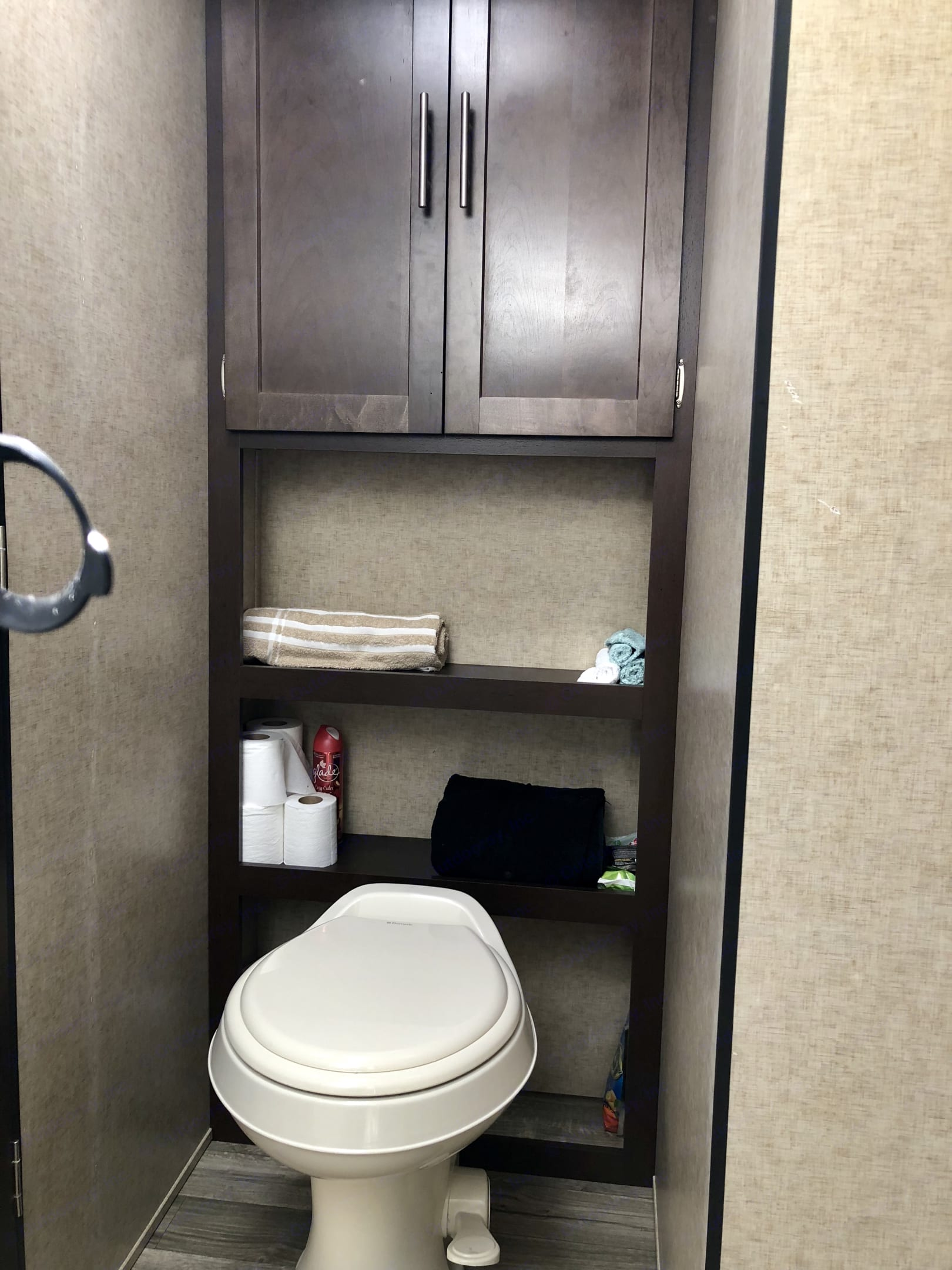 Nice linen storage above the toilet. We provide the toilet paper so that there is no damage to the septic system.. Forest River Cherokee Grey Wolf 2018