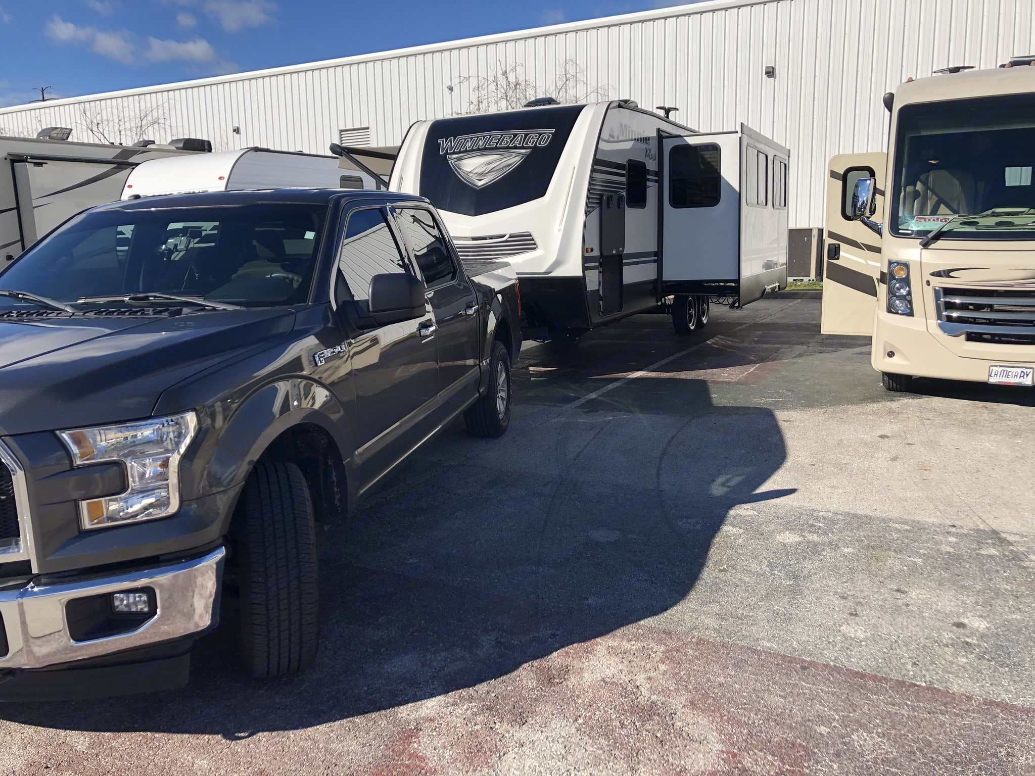 Easily towed with a v8 truck . Winnebago Mini 2019