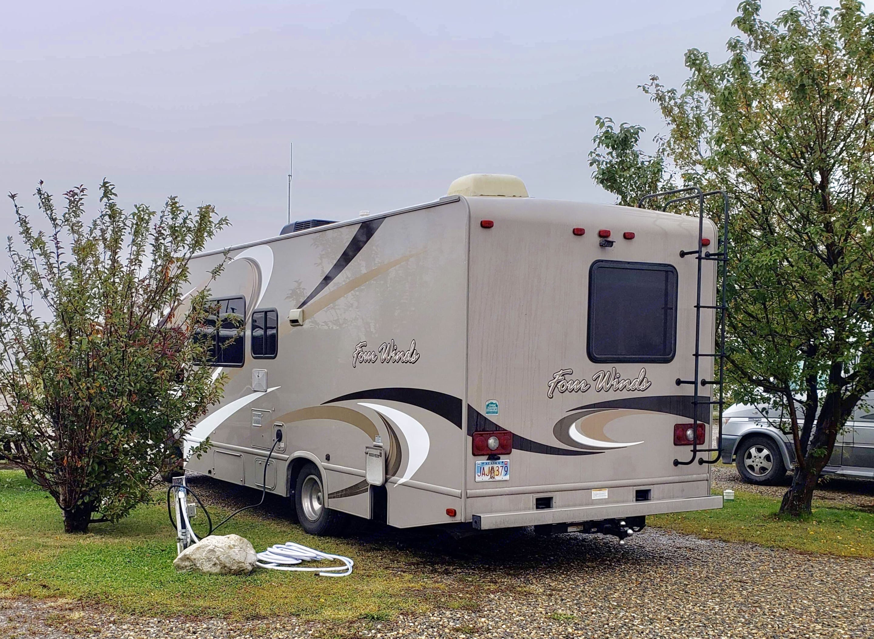 Rearview with electricy/water hooked up. Thor Motor Coach Four Winds 2015