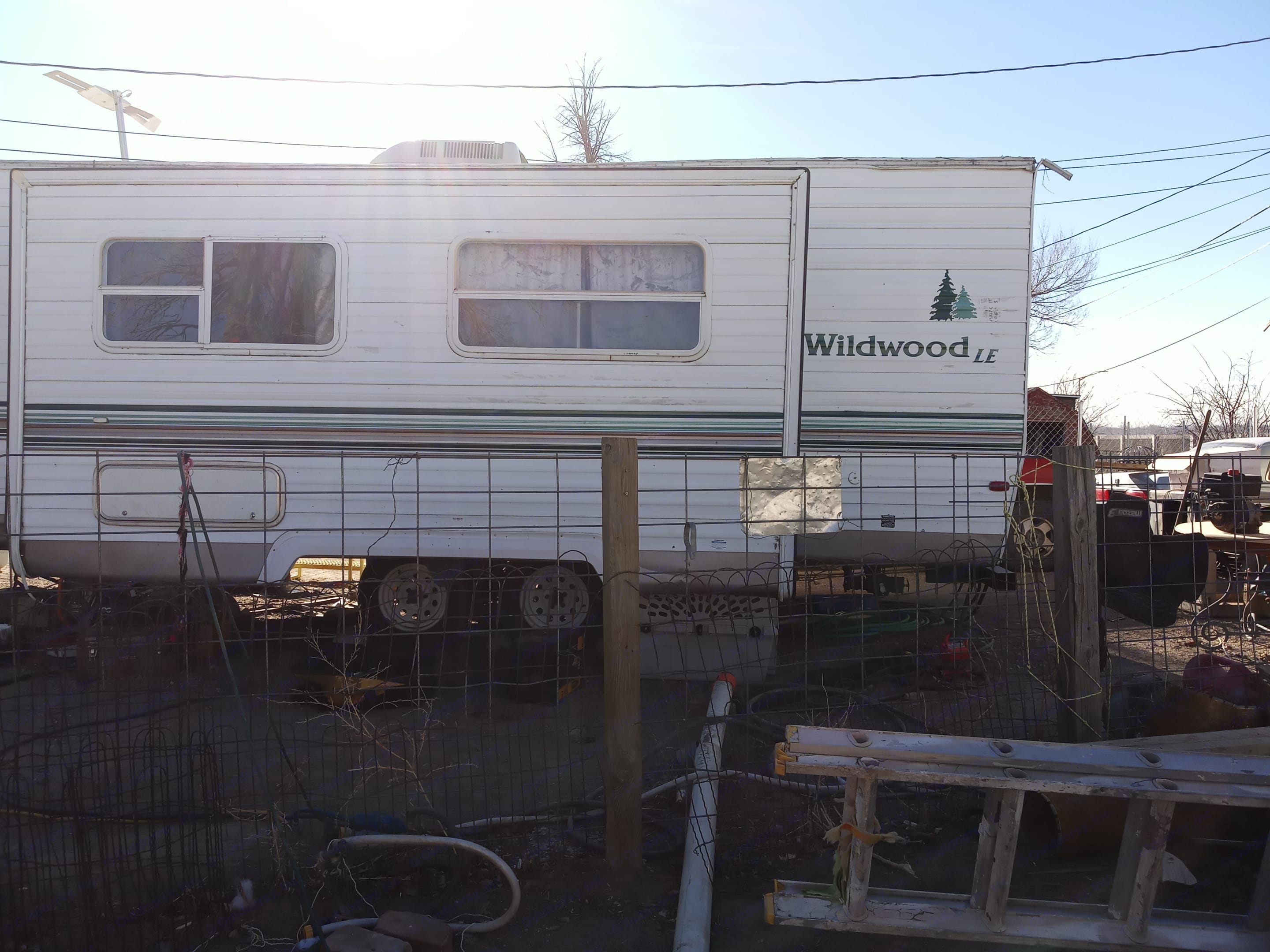 One side view of camper w/ pop-out. Wildwood 32qbss Other 2006