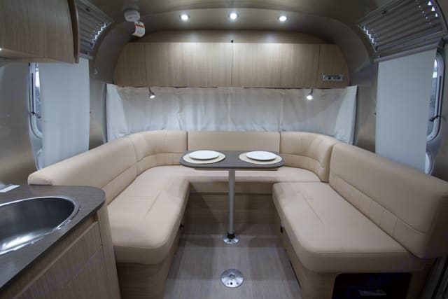 Lovely u-shaped dinette turns to an almost king sized bed or two twins for the kids. . Airstream Flying Cloud 2019