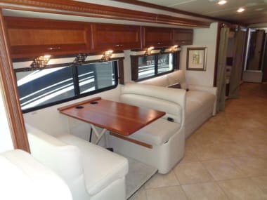 Main dining table for 4 people. Also converts to a bed. . Winnebago Forza 2014