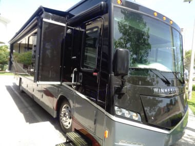 Beautiful exterior showing passenger side slide that runs the length of the coach. . Winnebago Forza 2014