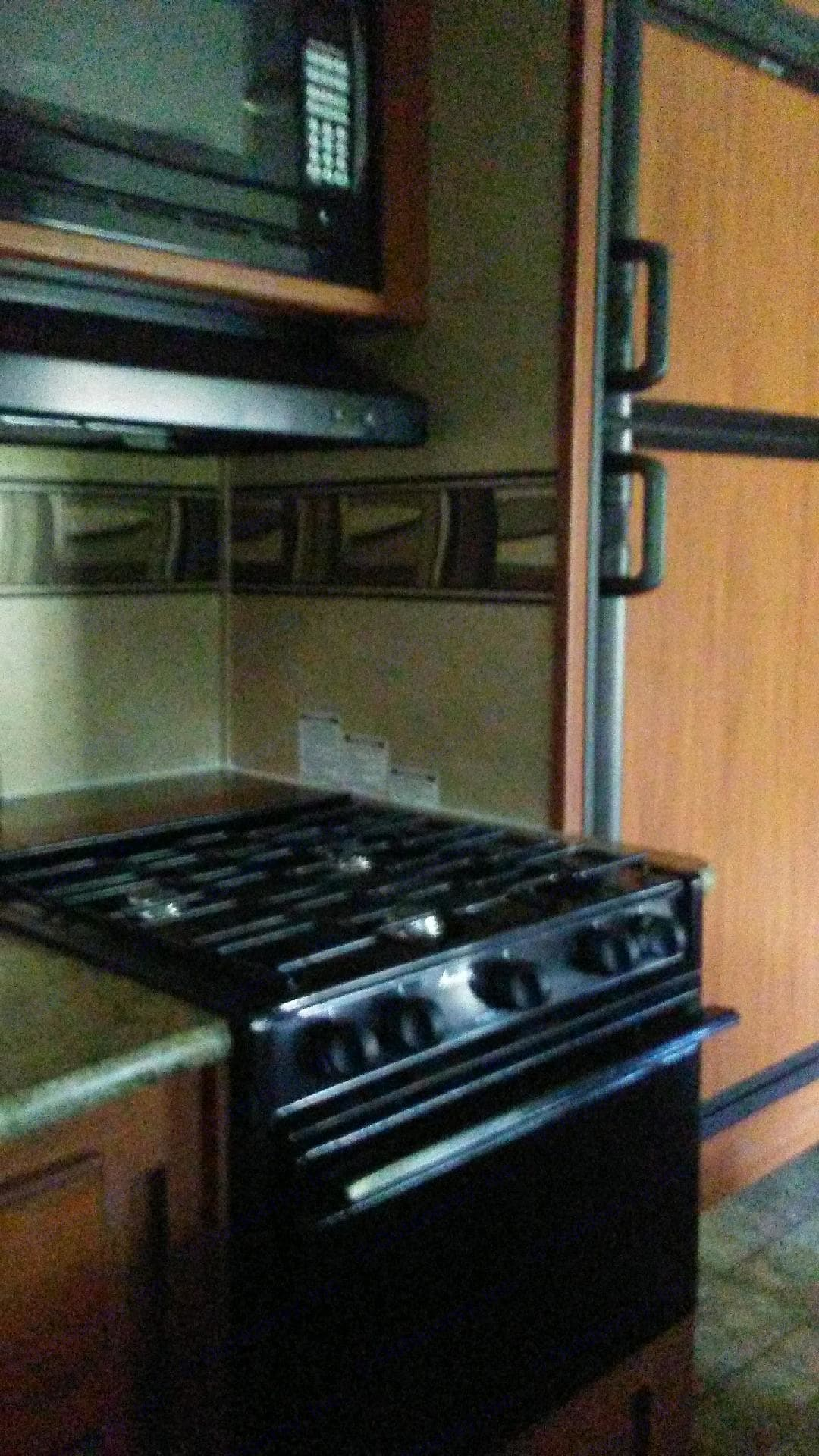 Gas stove with oven.. Forest River Surveyor 2012