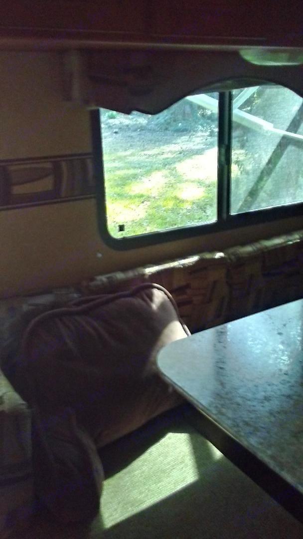 Comfy dinner area.. Forest River Surveyor 2012