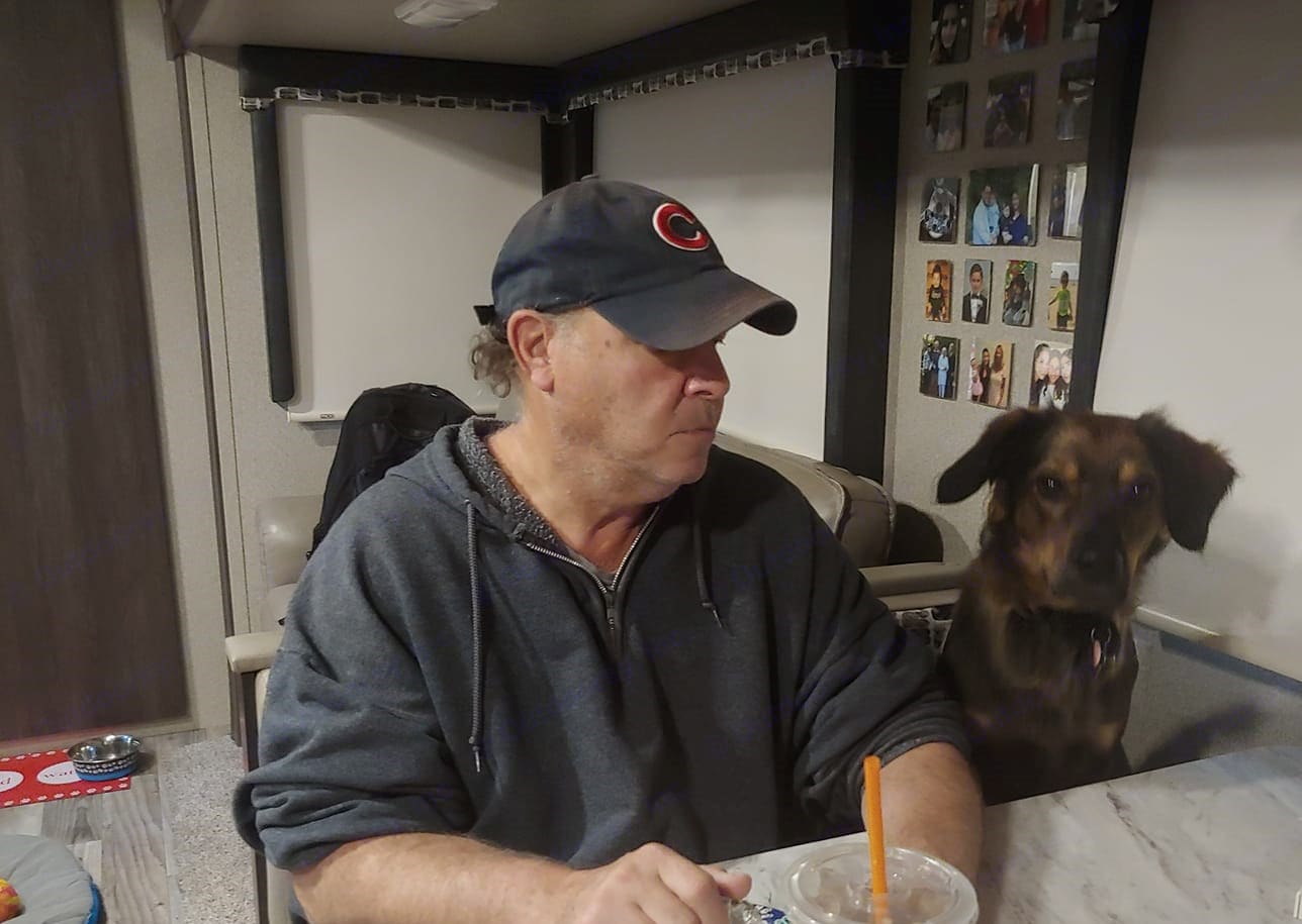 Our dog Charley likes to join us for breakfast. Keystone Outback 2018