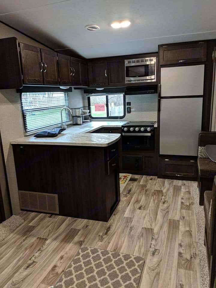 A large rear kitchen has everything you need to feed the group on your trip.. Keystone Springdale 2018