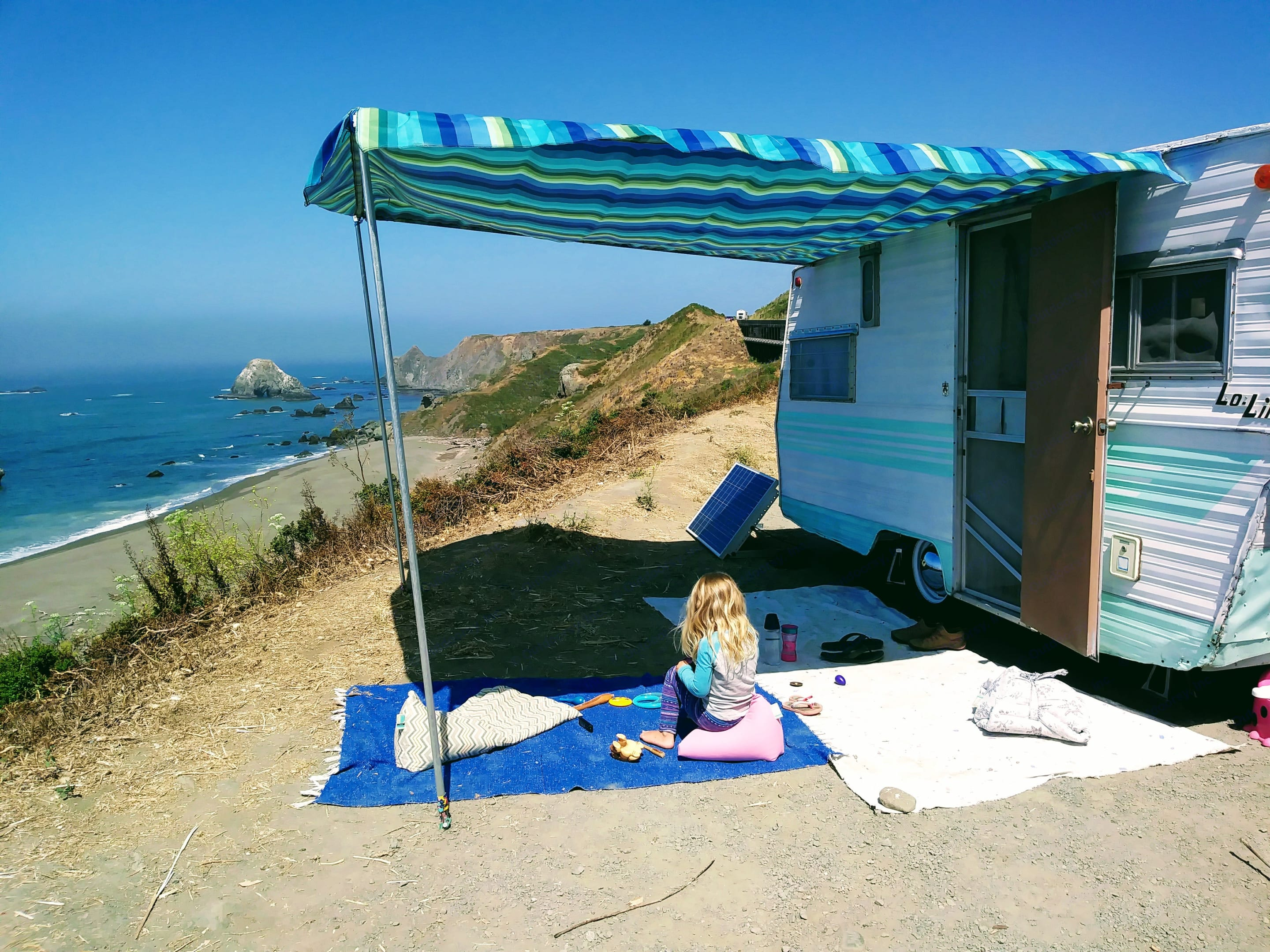 Large, homemade awning, perfect for a shady spot to chill and take it all in!. Aristocrat Lo-Liner 1968