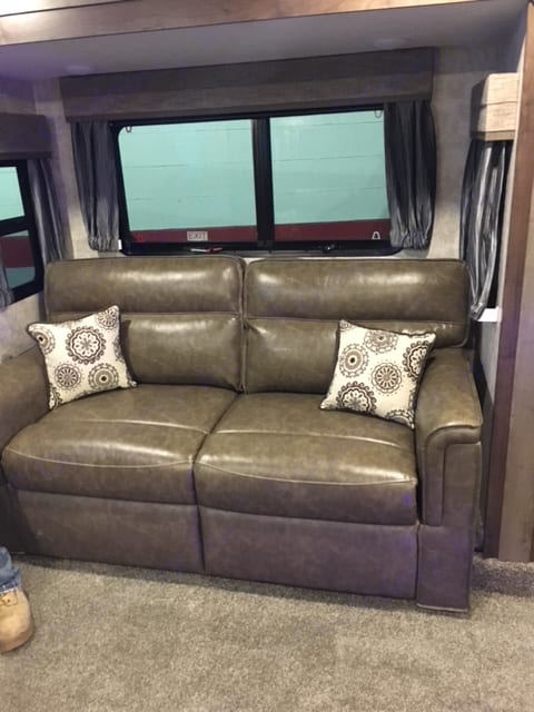 Two leather love seats that pull out to full size beds for extra guests. Open Range Open Range 2018