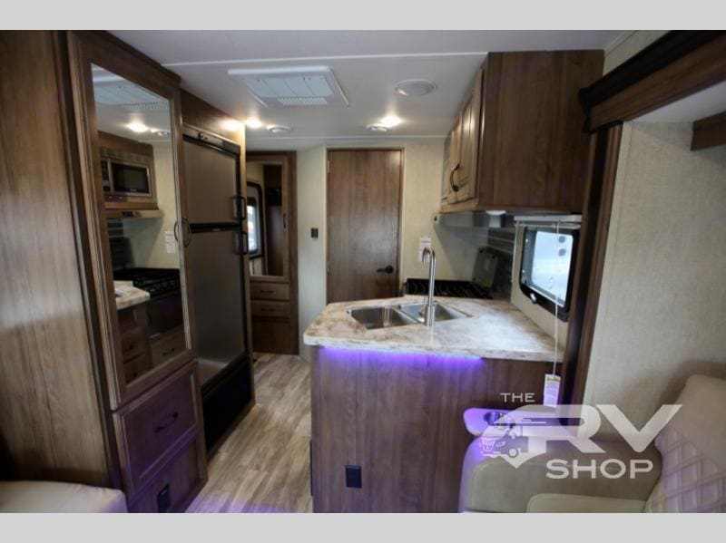 Fully equipped kitchen.  Plenty of storage and refrigerator room for our family of 6 for a week. . Gulf Stream B Touring Cruiser 2021