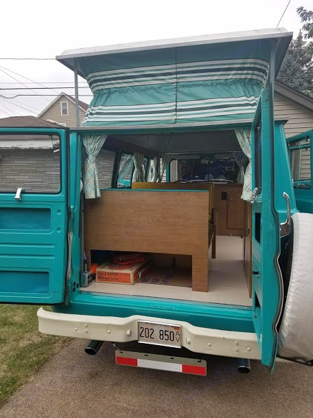 The rear of the CampWagon with the doors open and the poptop up.. Dodge CampWagon 1967