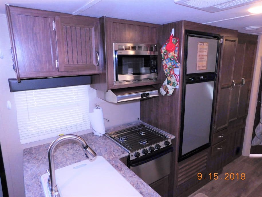 Enjoy all the amenities of home with this 3 burner stove, microwave, and fridge/freezer. Coleman 2855BH 2017