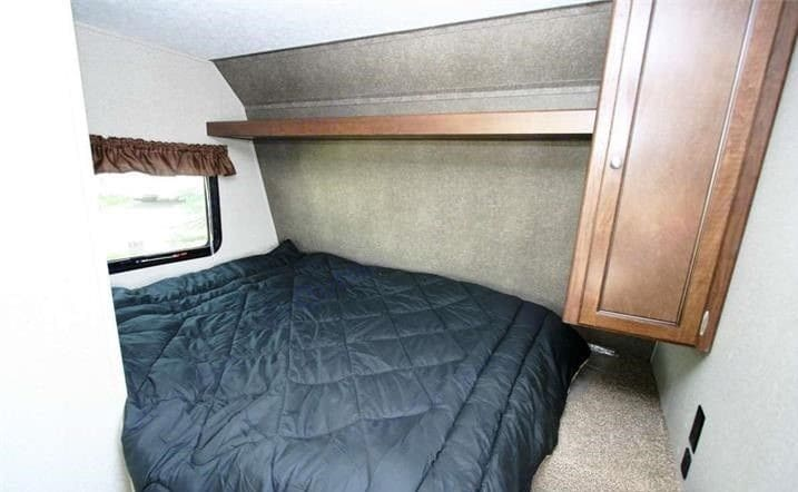 Queen Bed with storage above and wardrobe at end of bed. Hideout 177 2018