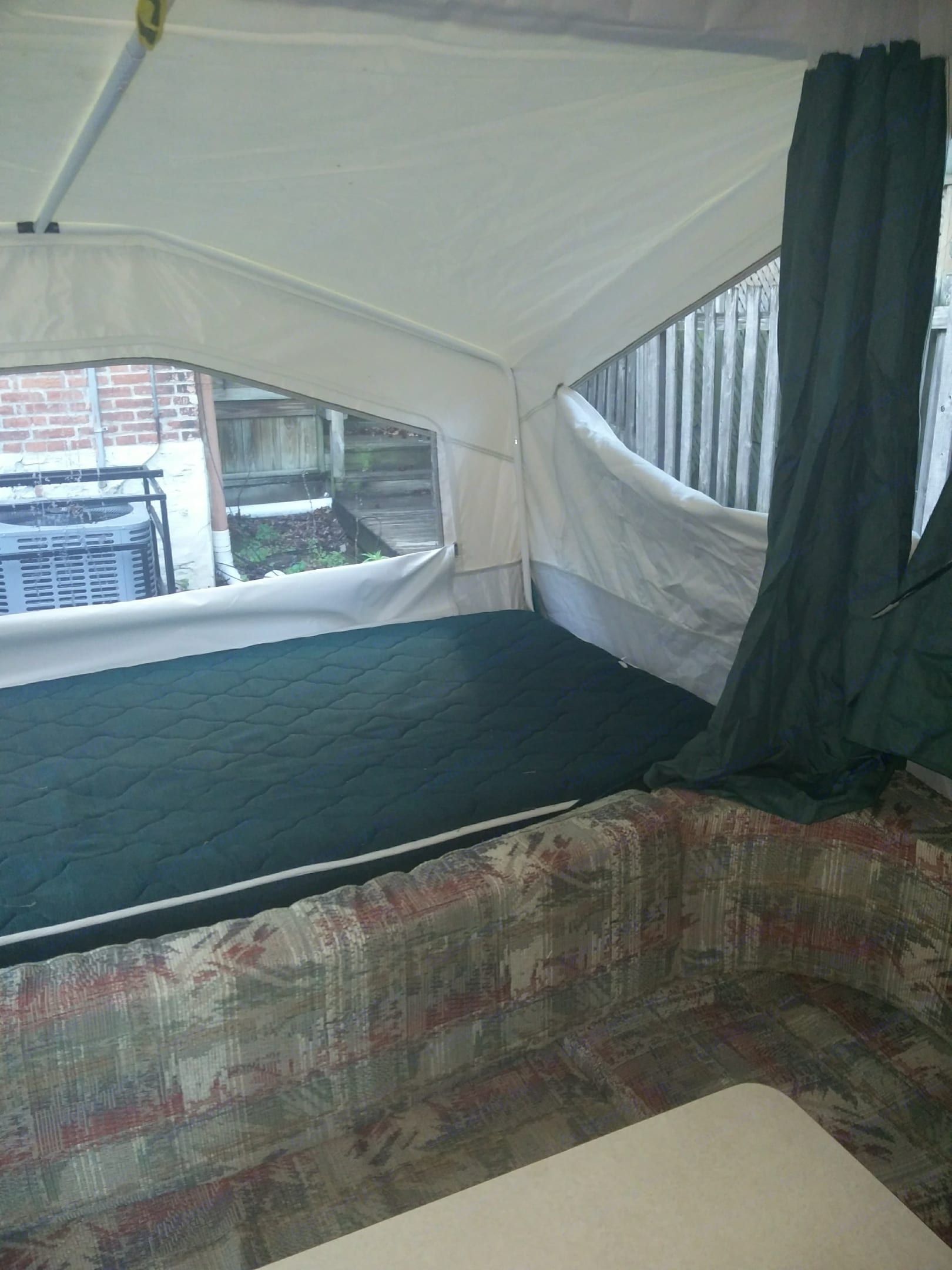 Full size bed with Ikea mattress and electric heater. Sleeps 2. Forest River Rockwood Freedom 2003