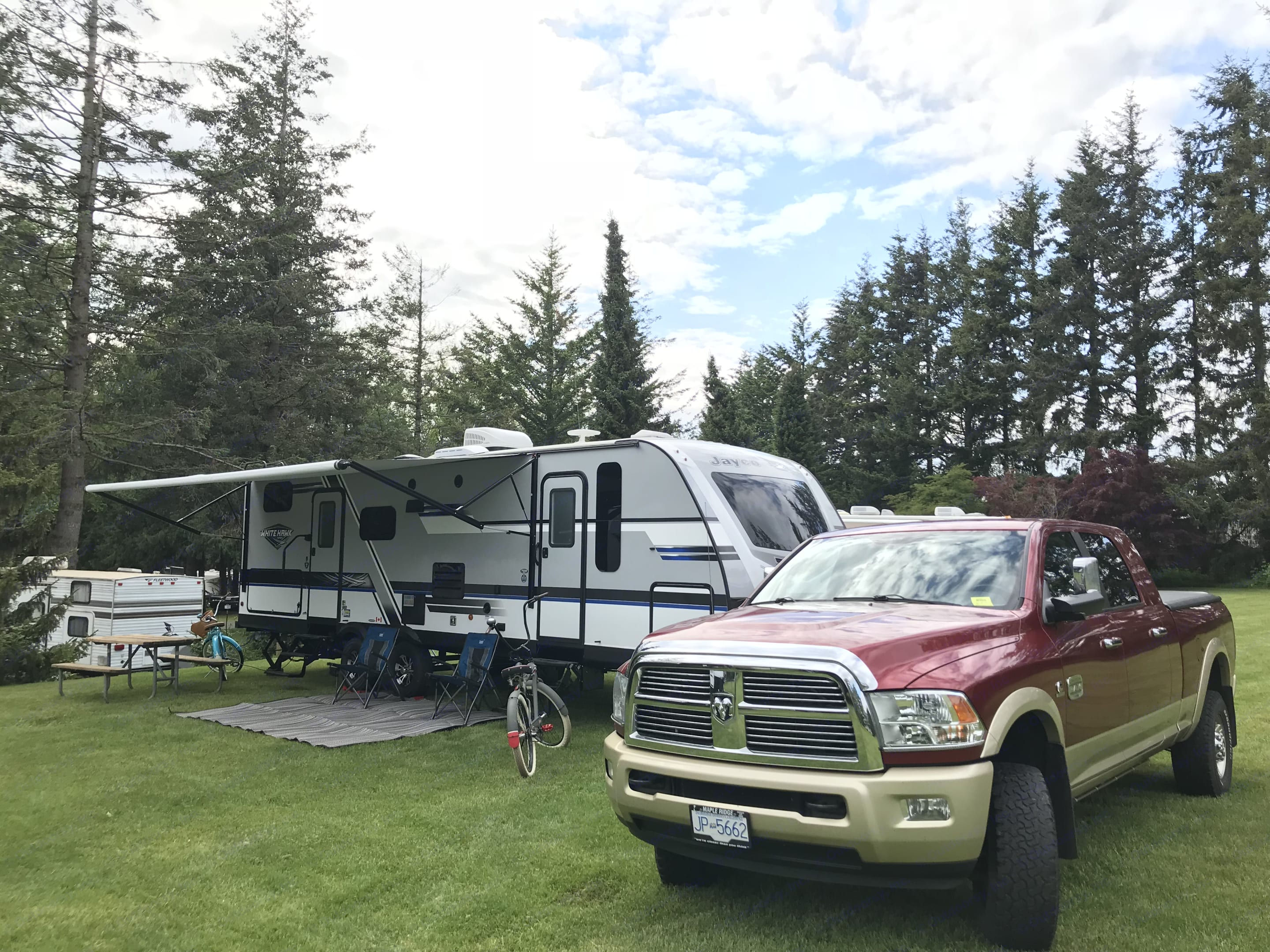 2018 29ft (34'4 total length) Jayco White Hawk with super slide. Sleeps 6 comfortably. Includes queen size residential mattress in Master bedroom, 2 double corner bunk beds and a convertible dinette.  Features an outdoor kitchen and shower.  All stainless appliance and solid surface counter tops.  Includes power awning with LED lighting, Bluetooth indoor and outdoor speakers and much much more.  This trailer doesn't disappoint! . Jayco White Hawk 2018