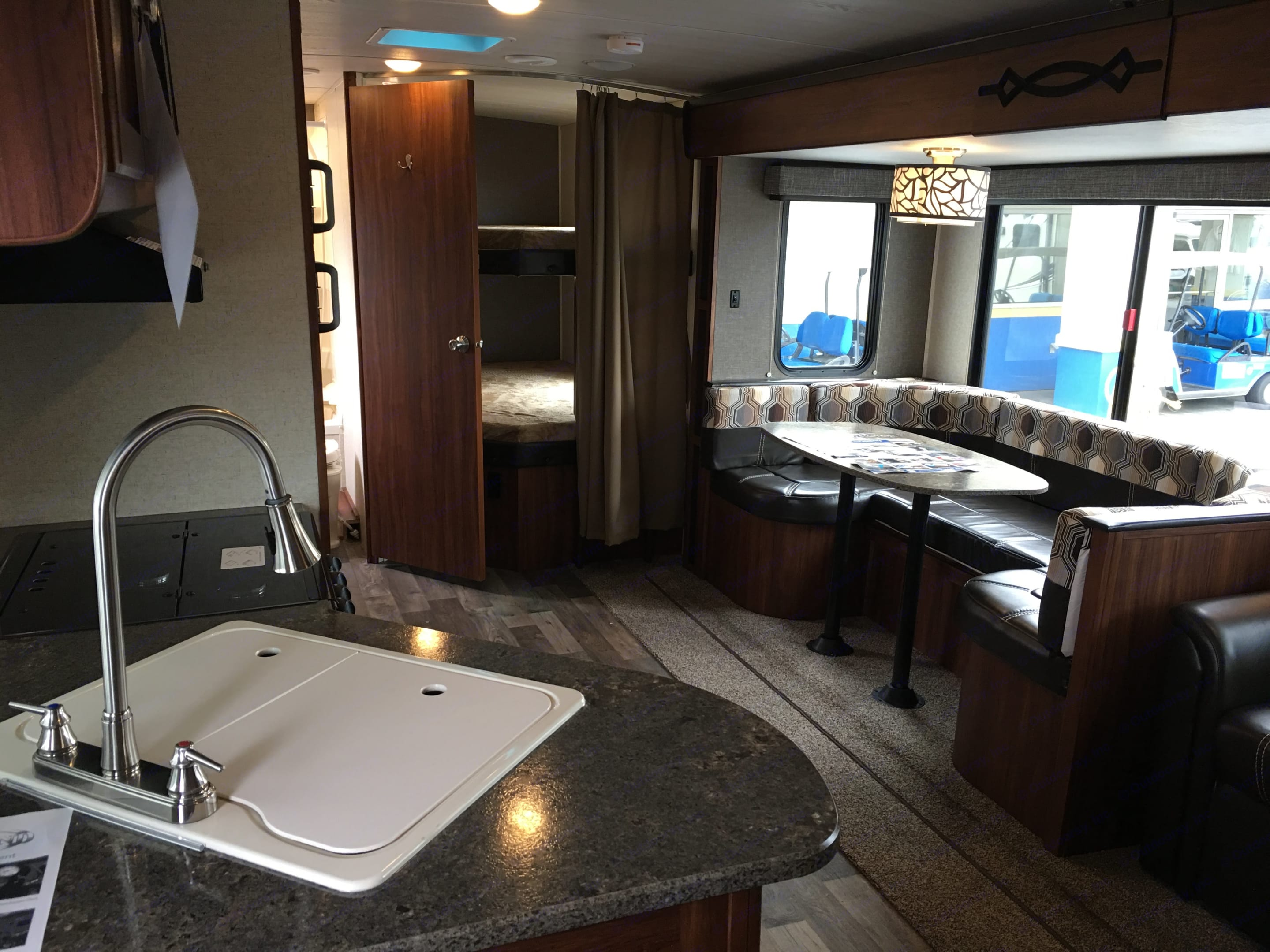 Kitchen table seats four comfortably. Also has storage underneath seats. Full sink & fully equipped kitchen. . Heartland Wilderness 2017
