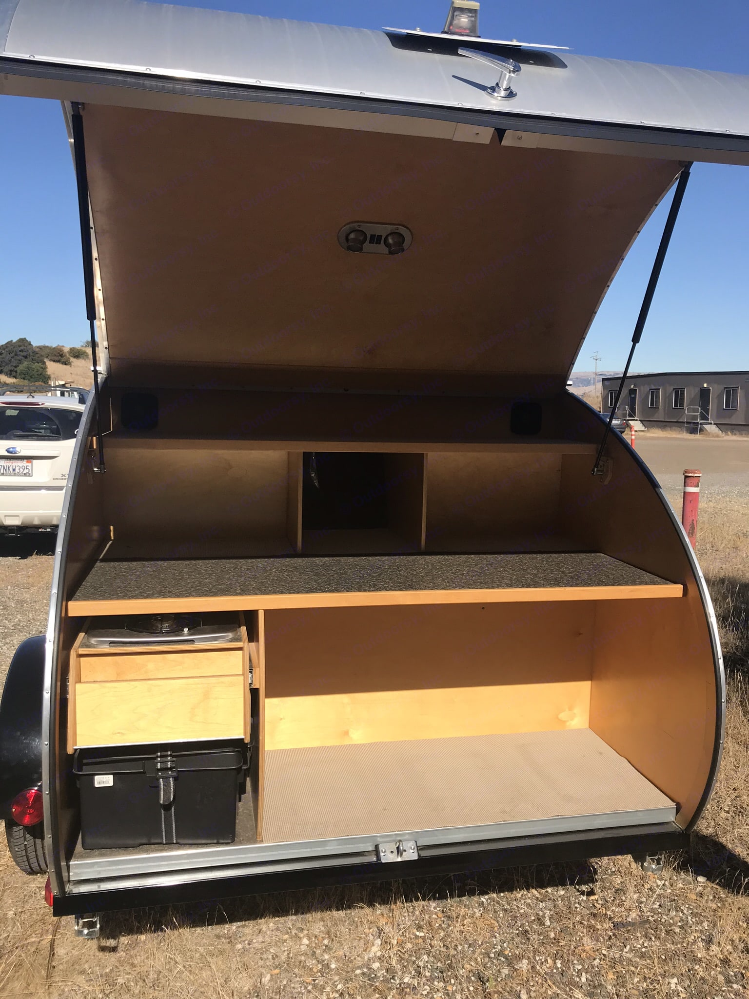 This is the rear hatch. It is also the galley area and the storage area. . American Teardrop Travel Trailer 2009