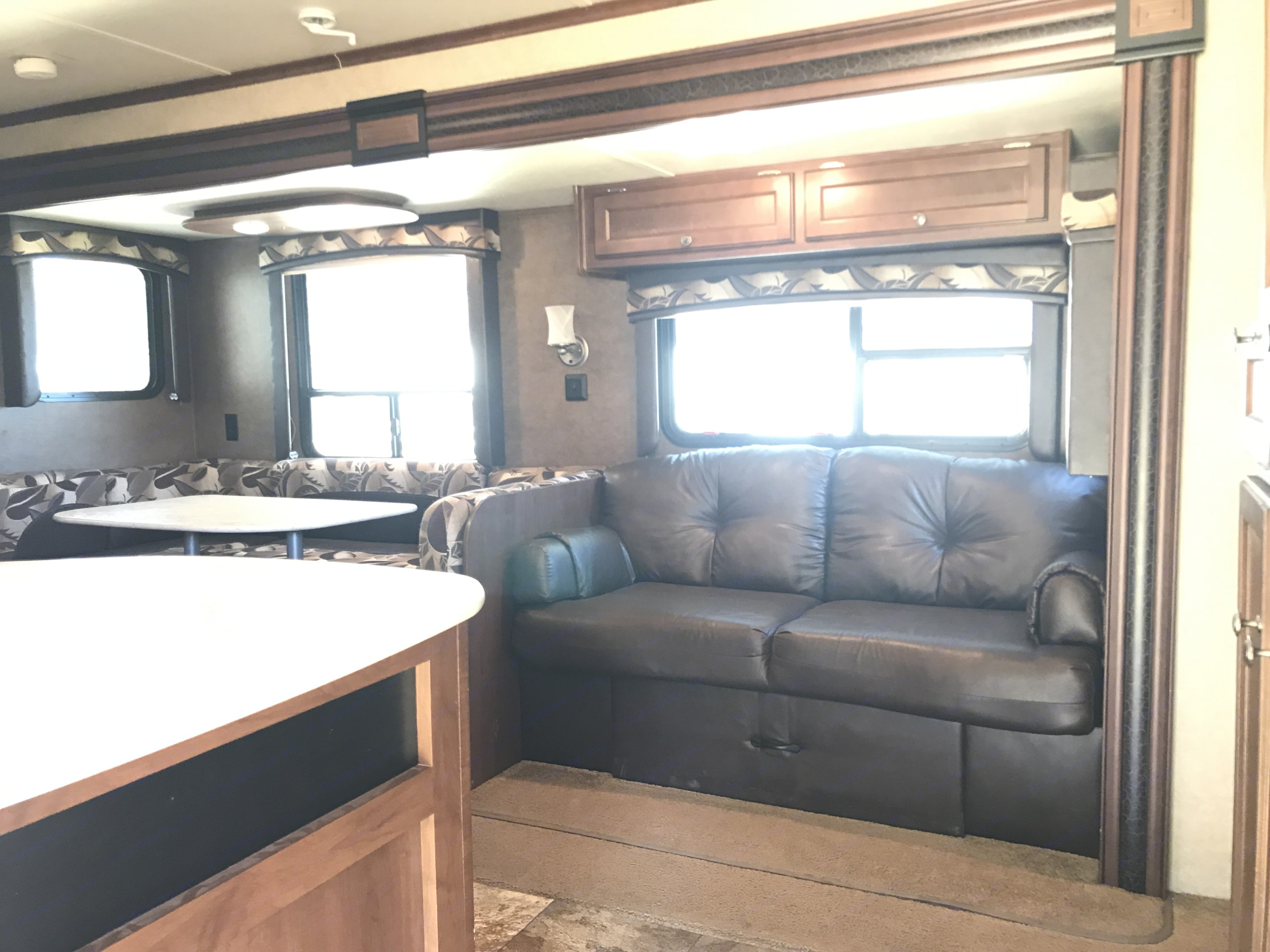 Looking into the RV from the front door.  There is a spacious bar with plenty of counter top prep area to your left.  The master is directly to the right.  The kitchen, bathroom and 4 bunkhouse bedroom is to the left. . Jayco Jay Flight 2015