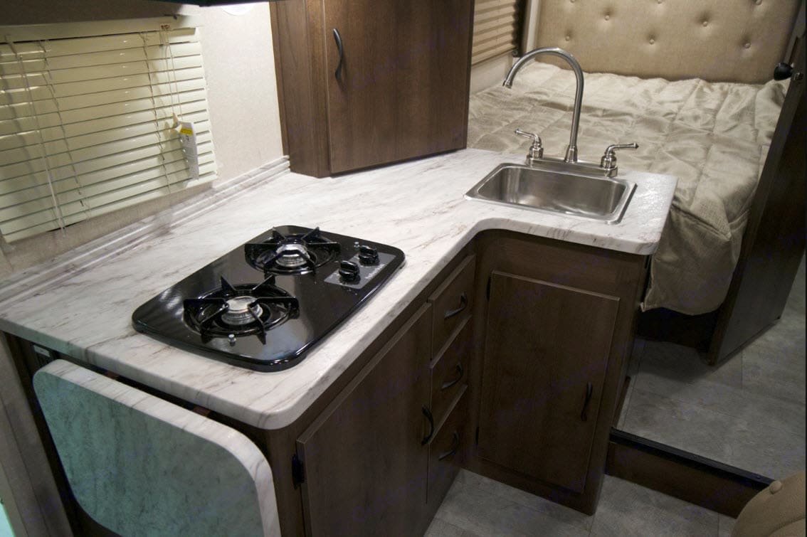Cooking station. Full size bed, upgraded with Serta mattress.. Coachmen Freelander 2020
