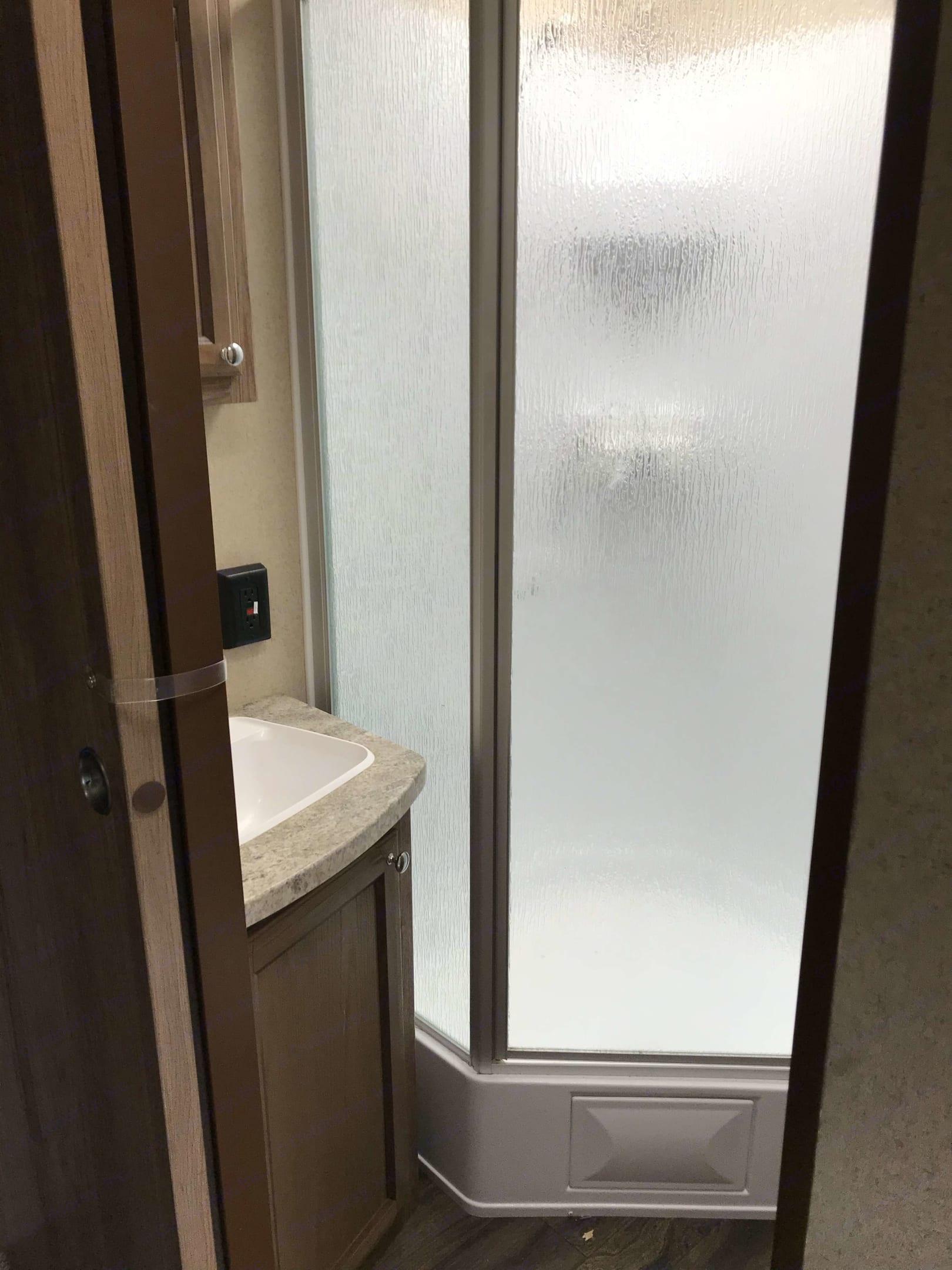 Bathroom SEA enclosed shower. Forest River Revere 2017