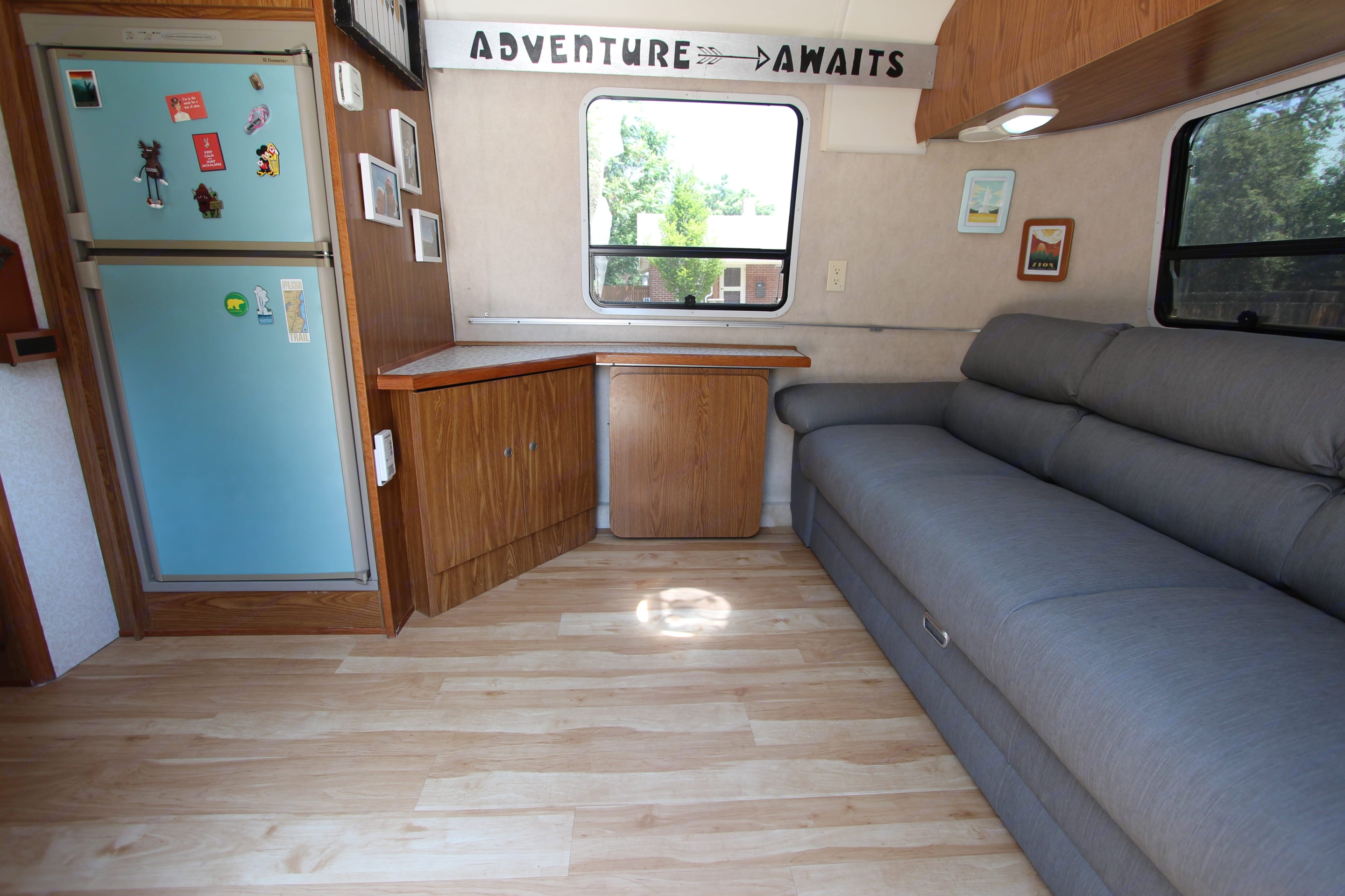 Table and chair can be stowed and couch folds out into bed. Airstream Safari 1999