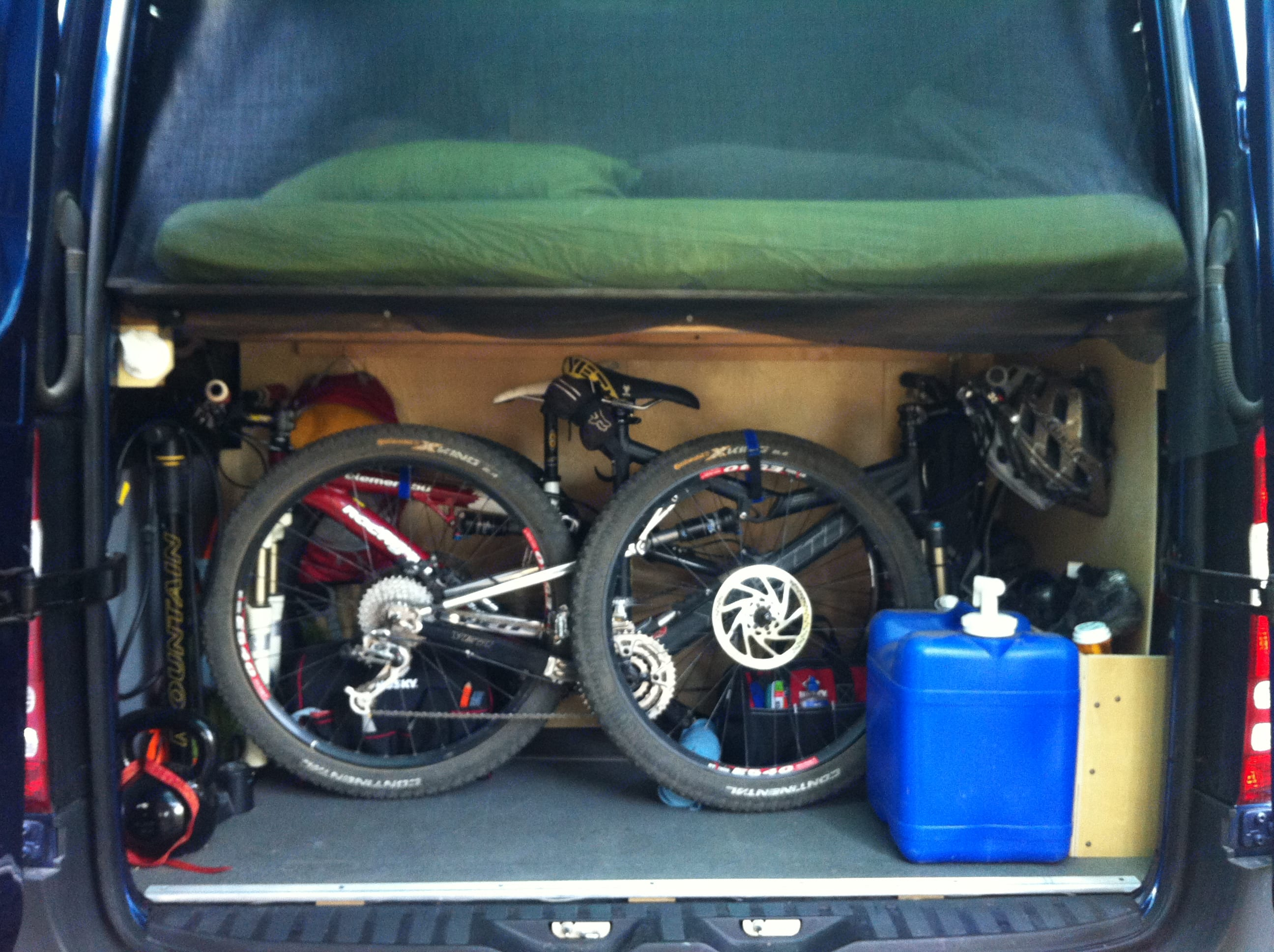 """You can access the """"garage"""" via the back doors or sliding doors from inside.  Plenty of room for bikes or other gear that you don't want in your way. . mercedes Sprinter 2011"""