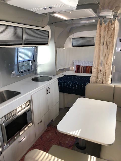 Kitchen and dinning - dinning table folds into additional bed.. Airstream Sport 2016