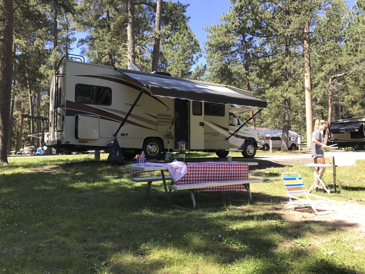 Typical setup showing awning. There is a massive amount of storage available underneath master bedroom that is accessible from three sides.. Coachmen Leprechaun 2017