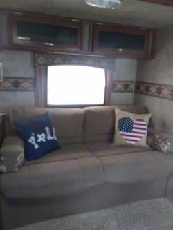 Jackknife sleeper sofa, can accommodate sleeping area for a child or petite person . Keystone Passport 2015