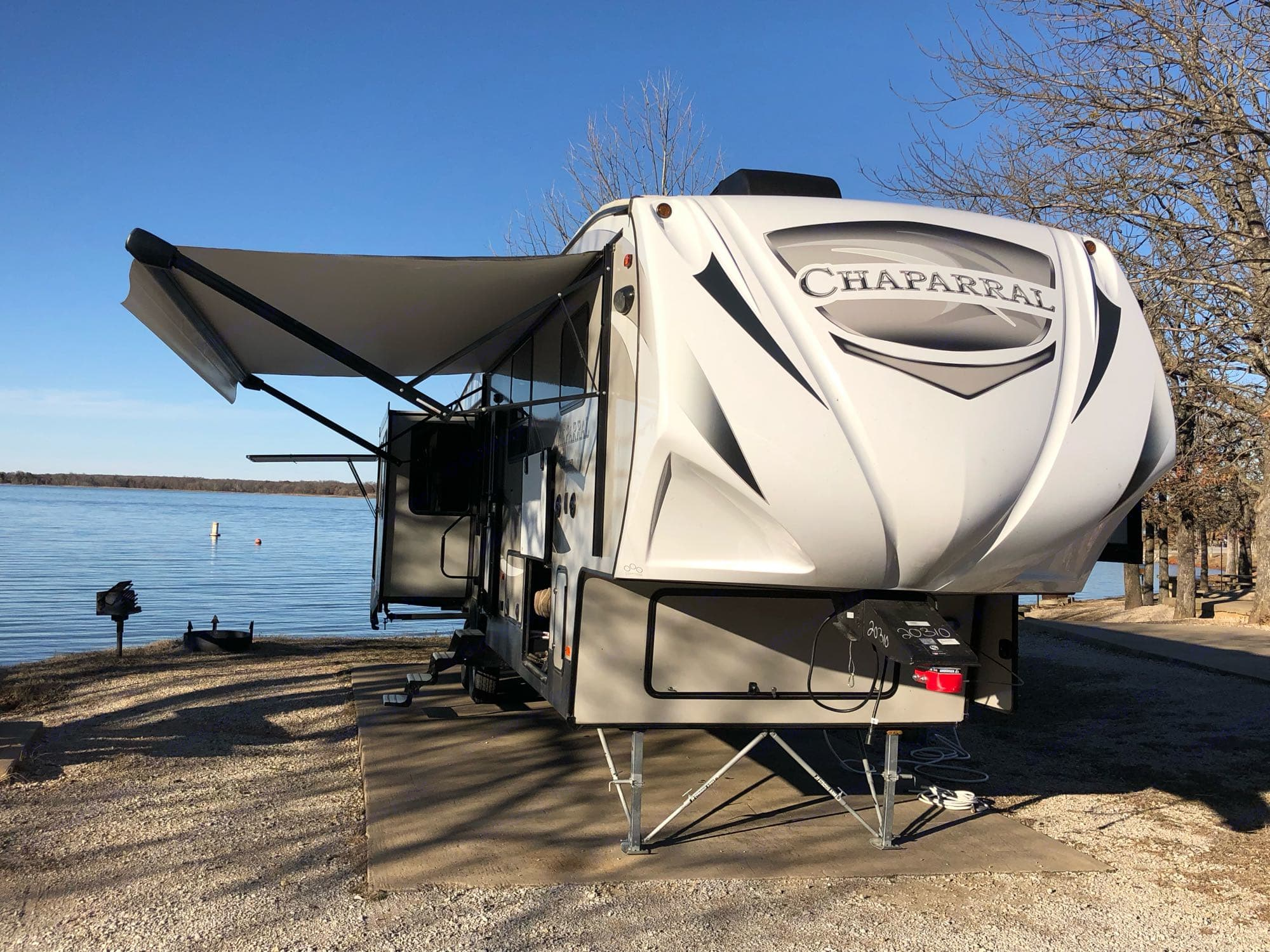 2019 Coachmen Chaparral 392MBL with awning and slide outs extended . Coachmen Chaparral 2019