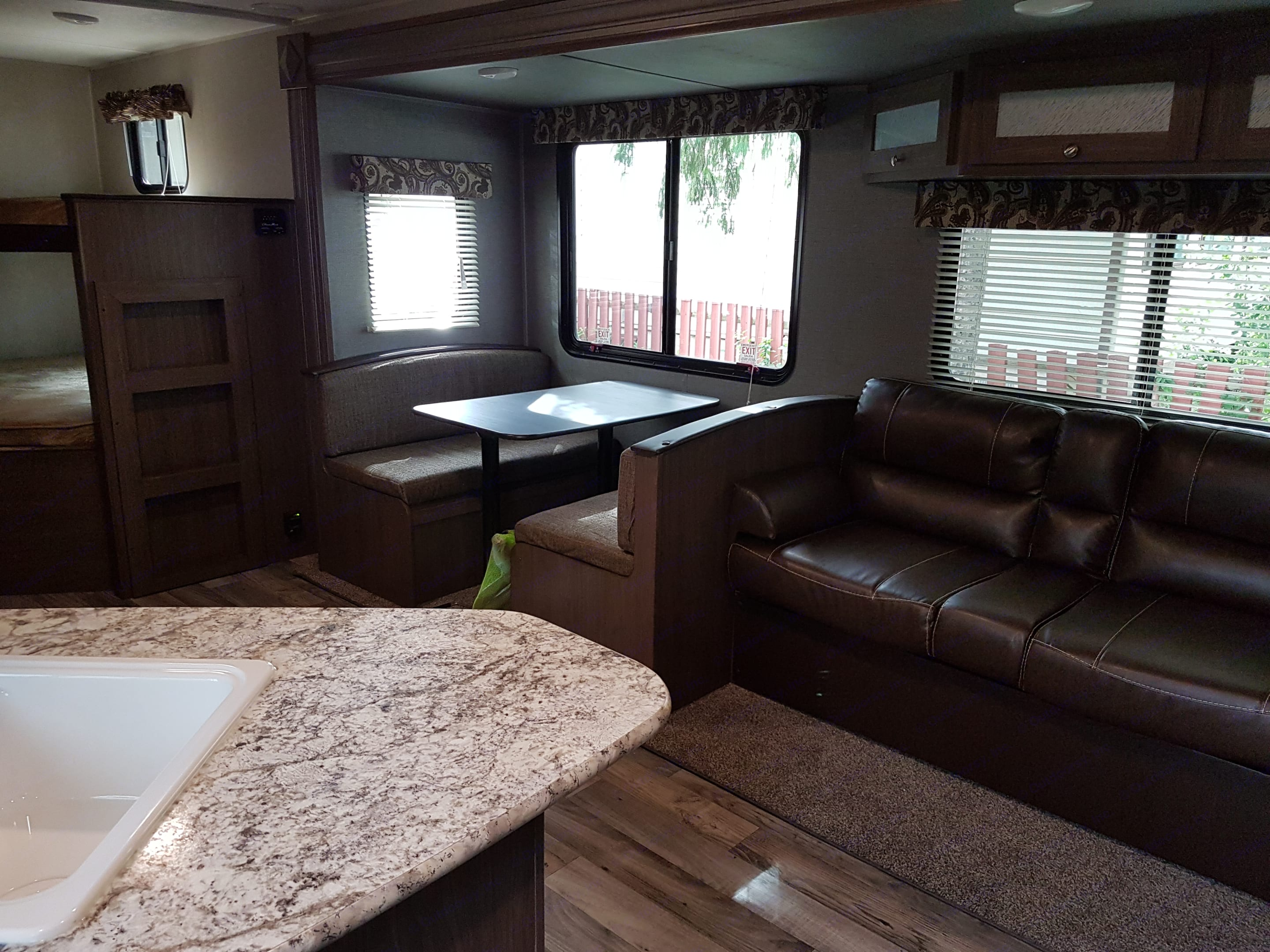 Couch and Table easily fold into beds for extra sleepers. Keystone Hideout 272LHS 2018