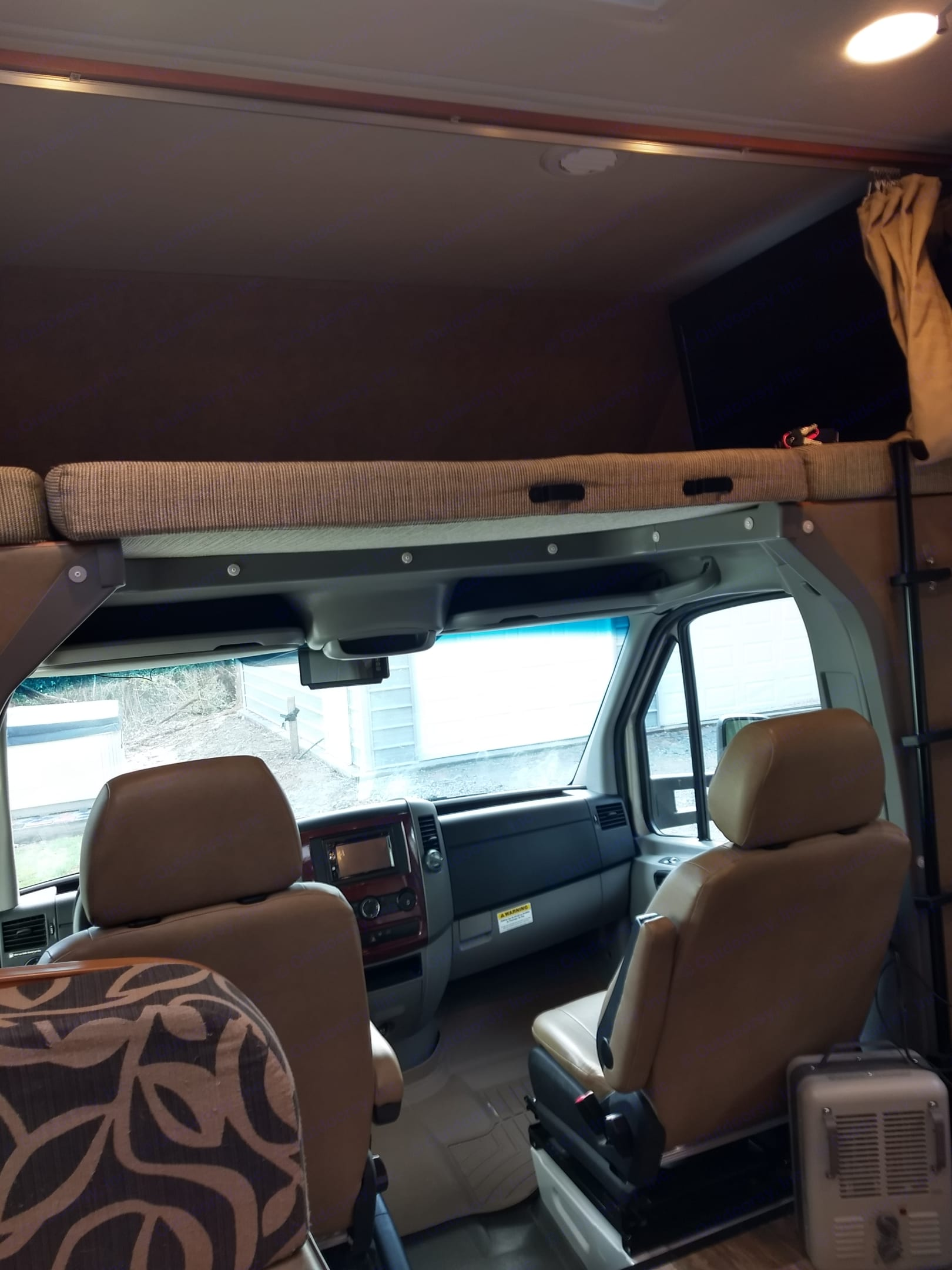 Bunk bed with ladder for easy access tucked up over the cab. Forest River Forester 2015
