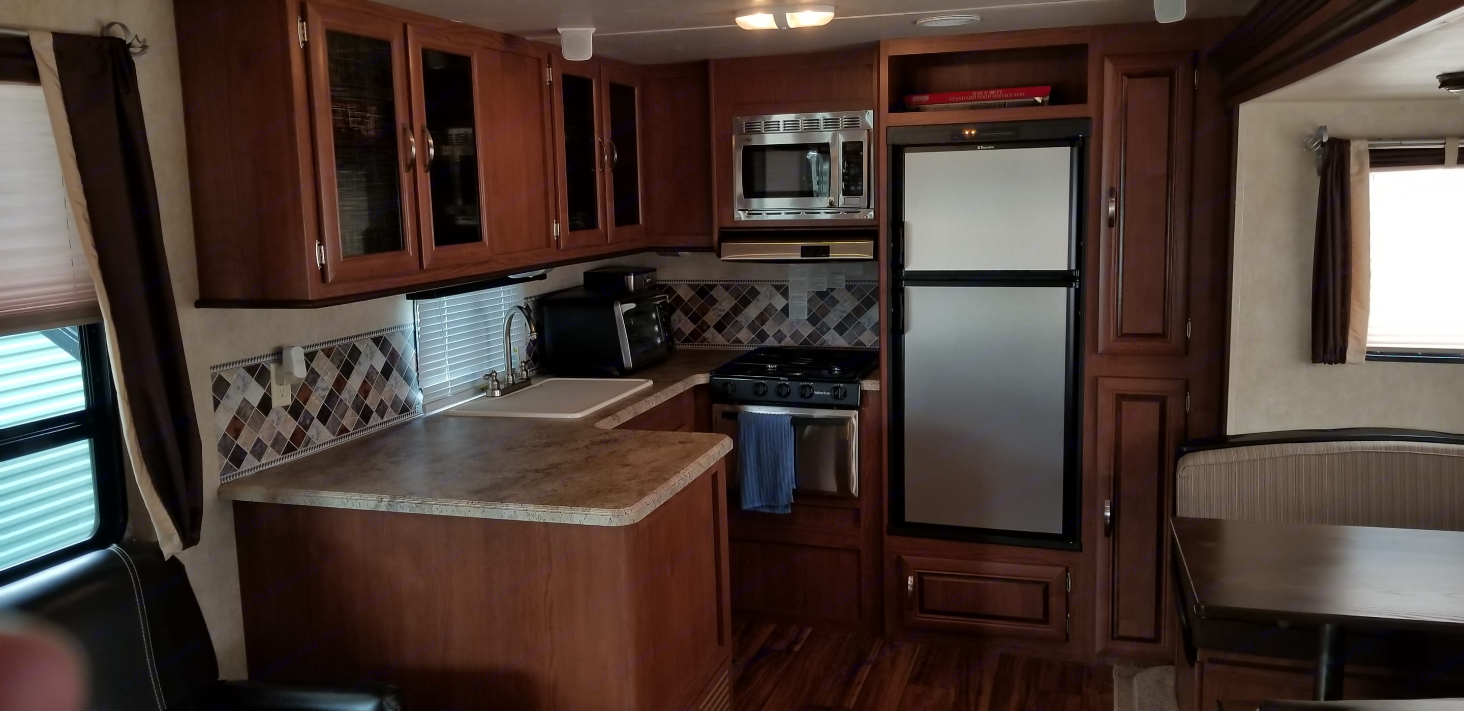 Micro wave,Oven, 3 Burner Stove, Pan Tree, lots of storage space. Forest River Wildwood 2016