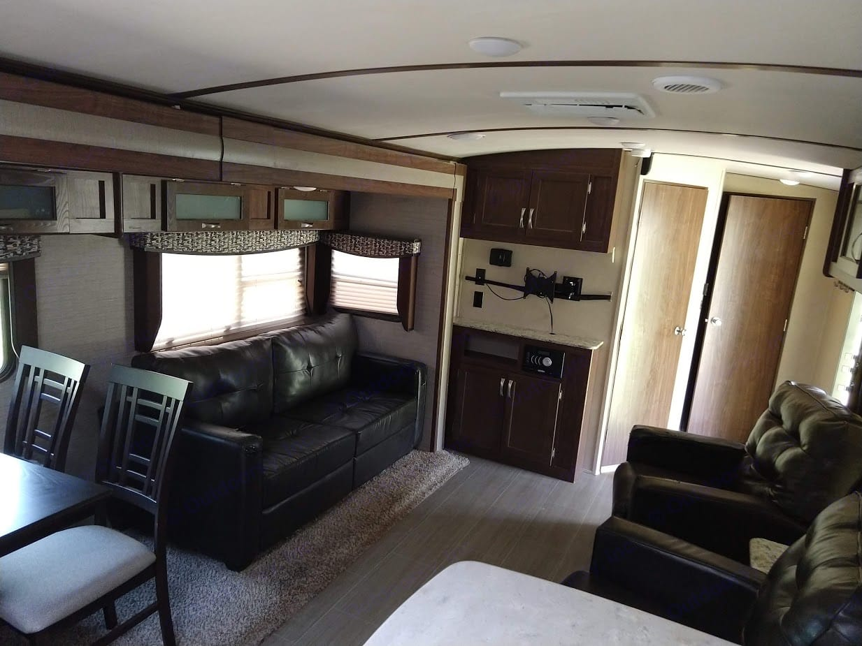 Roomy leather furniture, with reclining chairs.. Aerolite Travel Trailer 2018