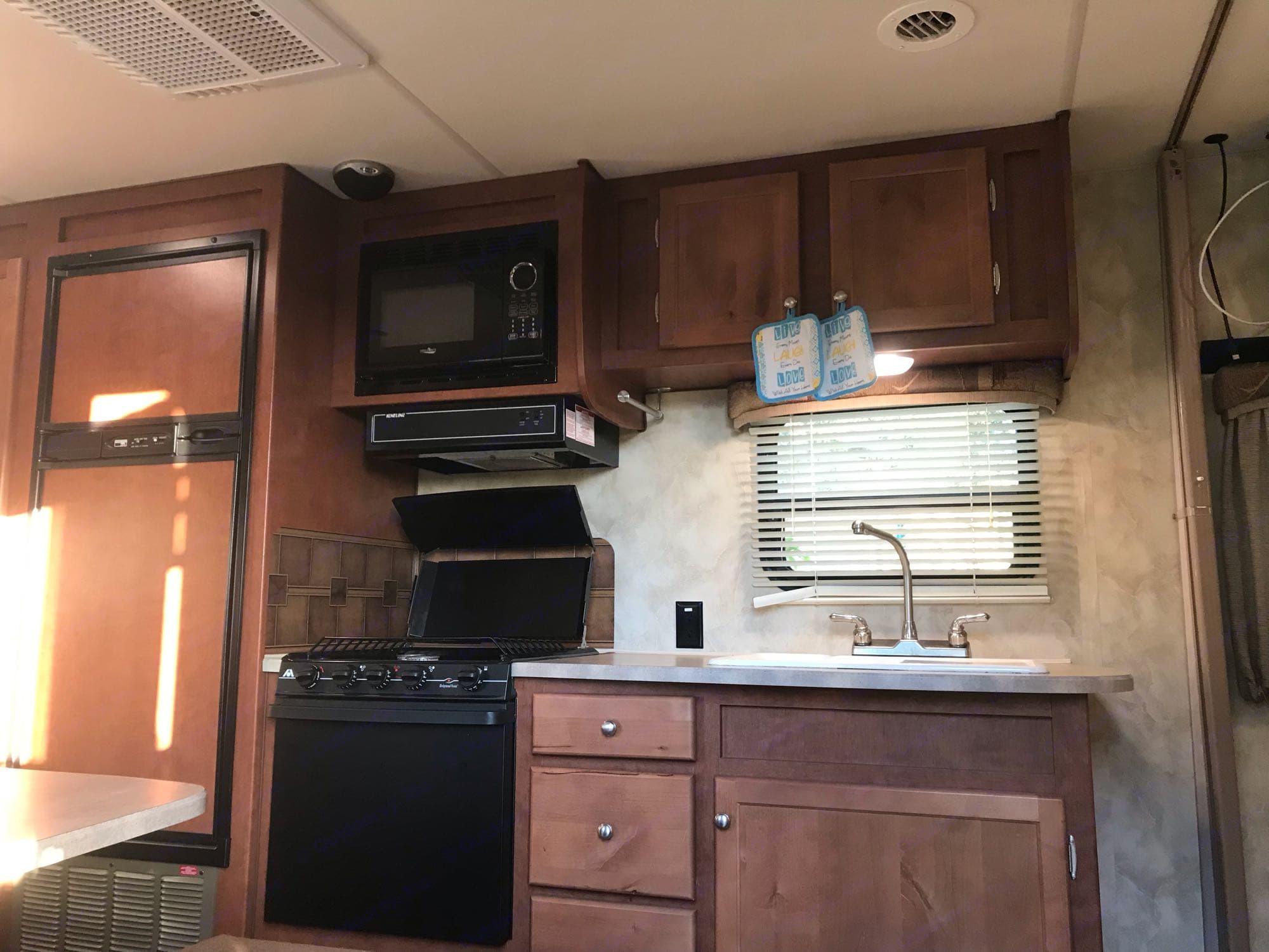 kitchen has 3 burners a big sink and lots of storage . Northwood Mfg Nash 2015