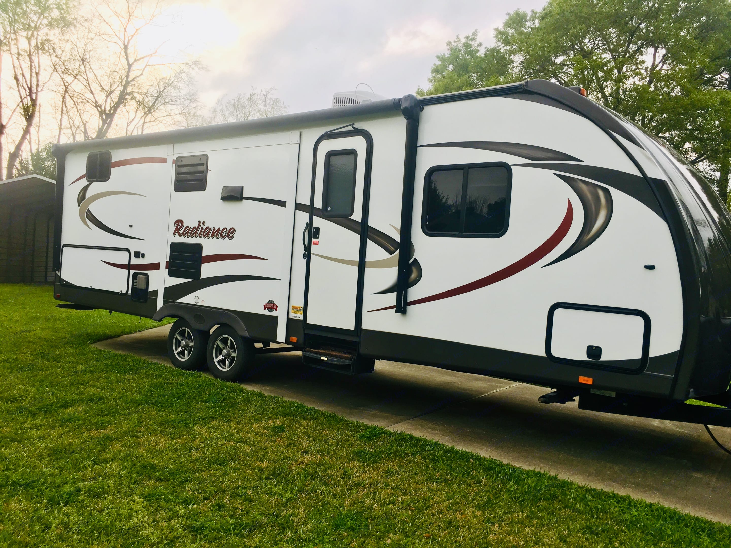 Front entry view of trailer showing kitchen slideout. Cruiser Rv Corp Radiance 2016