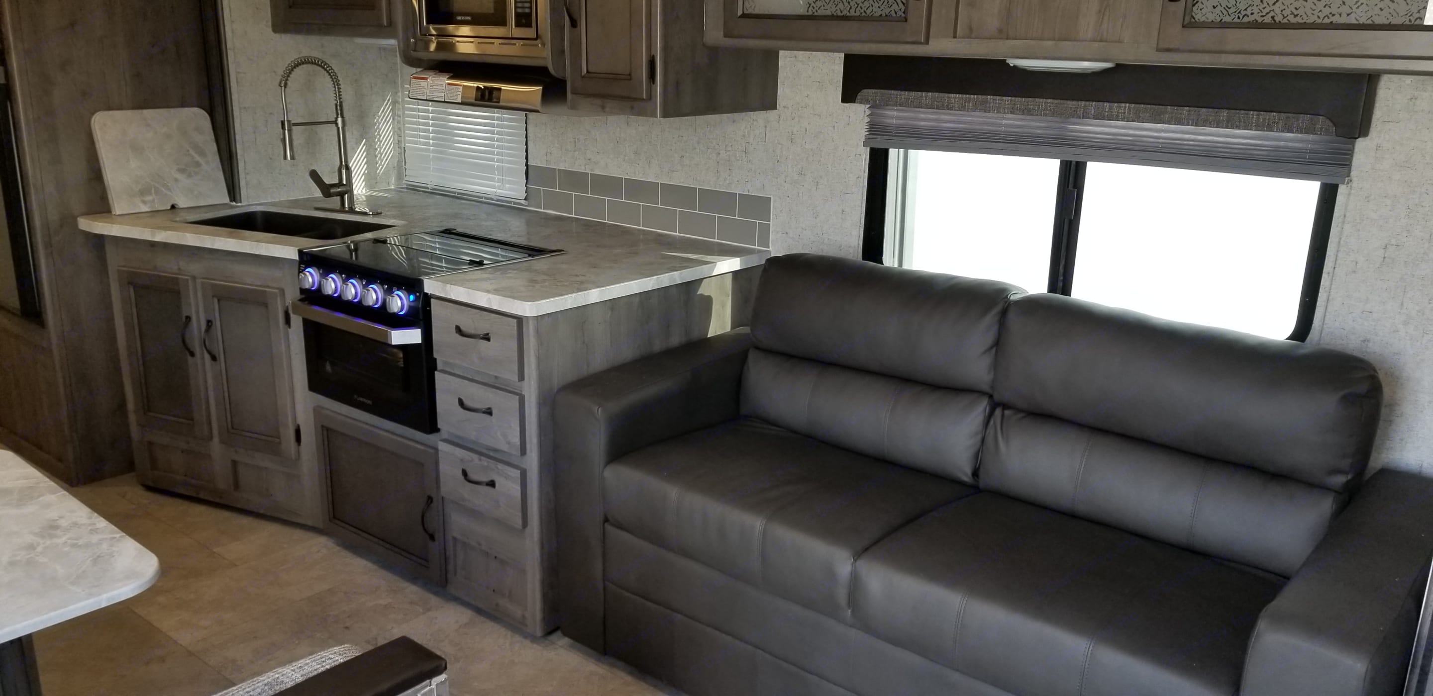 The couch in normal couch mode. . Coachmen Apex 2019
