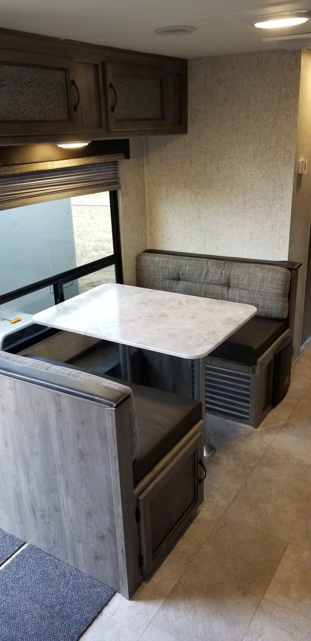 Dining room table with large window that faces the camp site. Coachmen Apex 2019