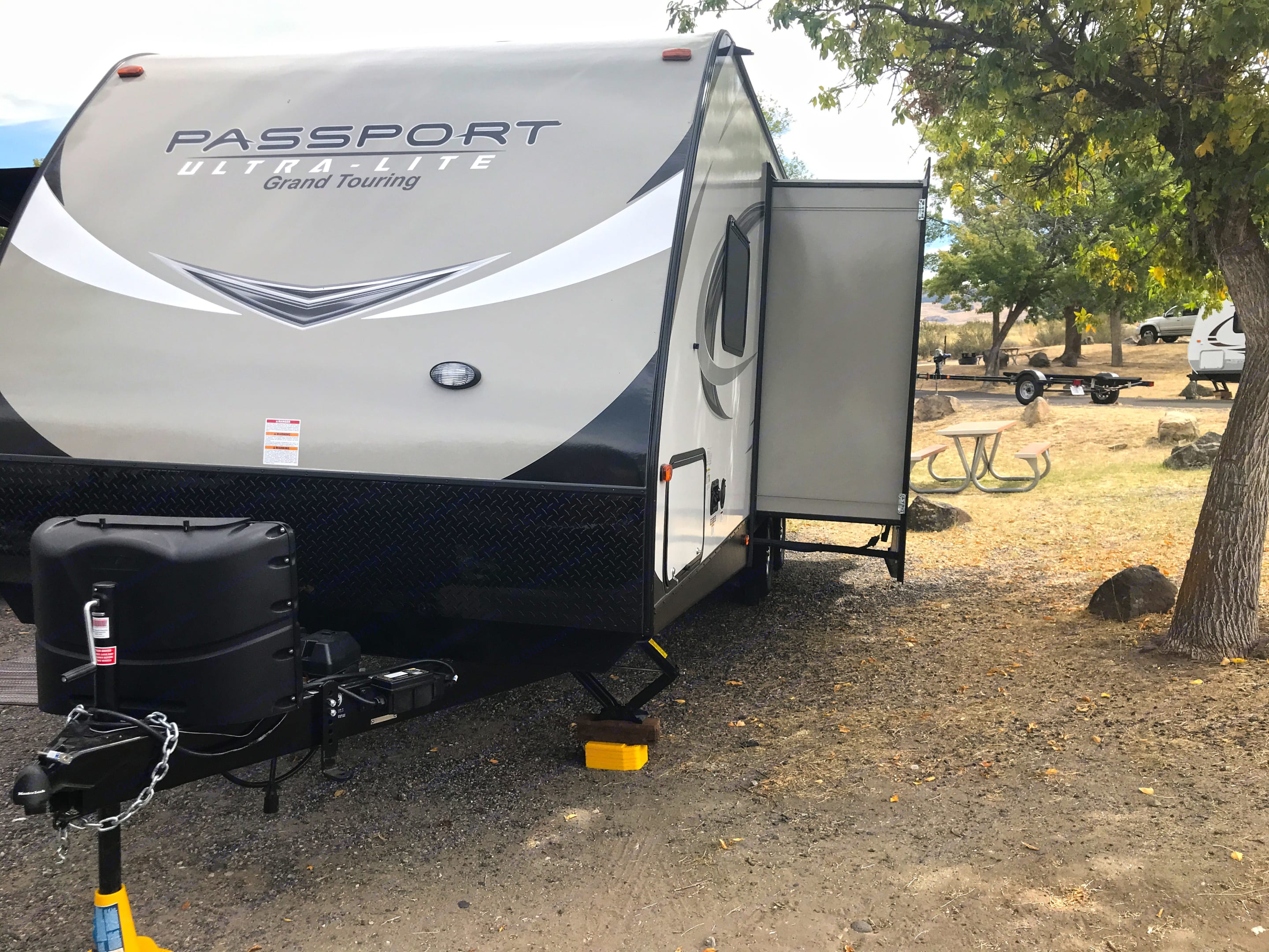 Slide out on the left (driver) side of the trailer. Keystone Passport 2018