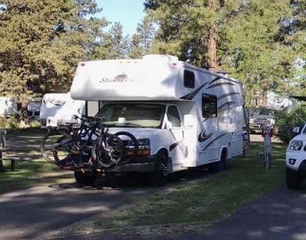 Mt Bike Trip - Bikes on front and back!  great shuttle RV . Forest River Sunseeker 2013