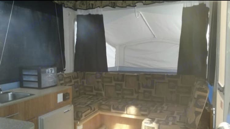 Sitting area has optional table, King bed is behind. Jayco Jay Series 2008