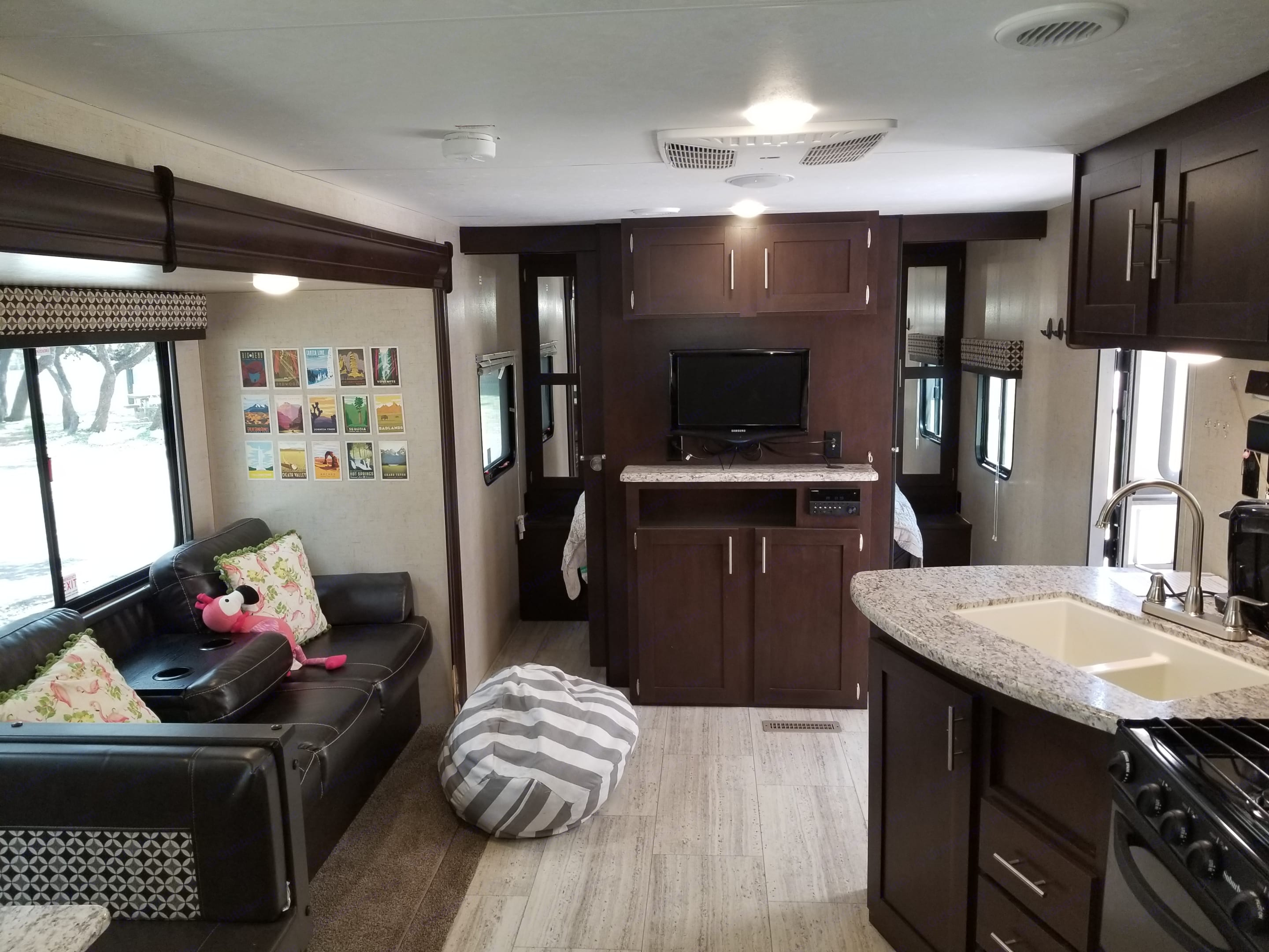 Entertainment area, also houses the indoor/outdoor stereo, queen bed is behind the cabinet -- 2 pocket doors provide extra privacy. . K-Z Manufacturing Sportsmen 2017