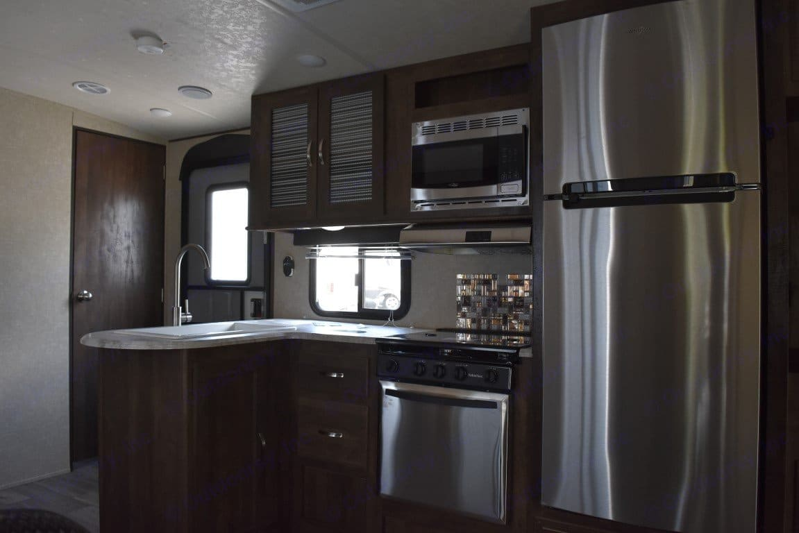 Full Kitchen with Stainless steel appliances . Forest River Vibe 2018
