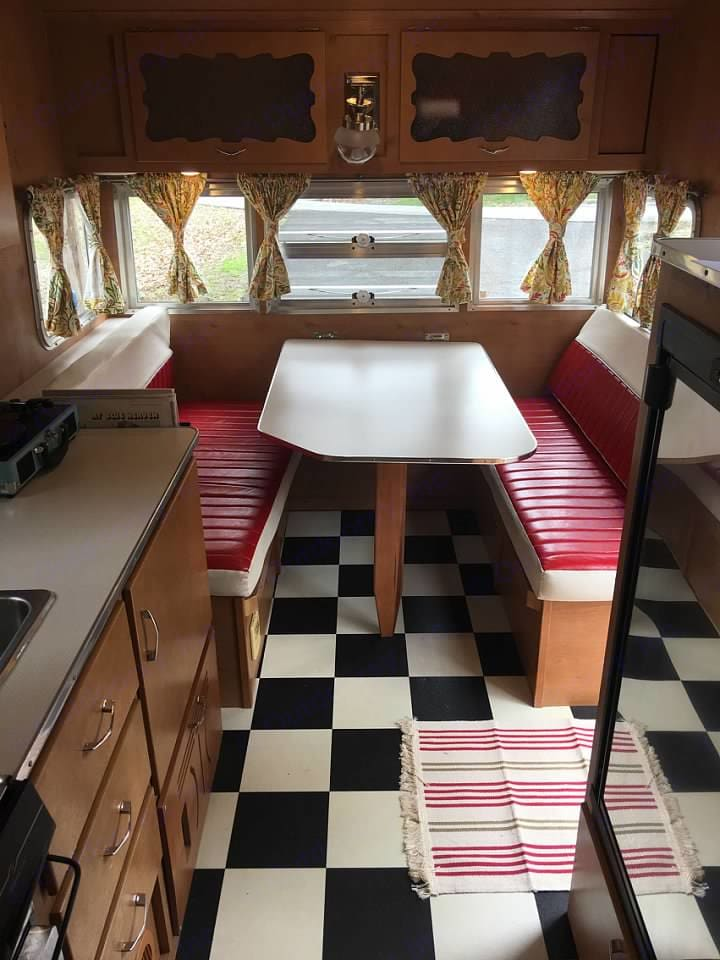 Front inside of the Ham. This table turns into a full size bed.. Shasta Airflyte 2015