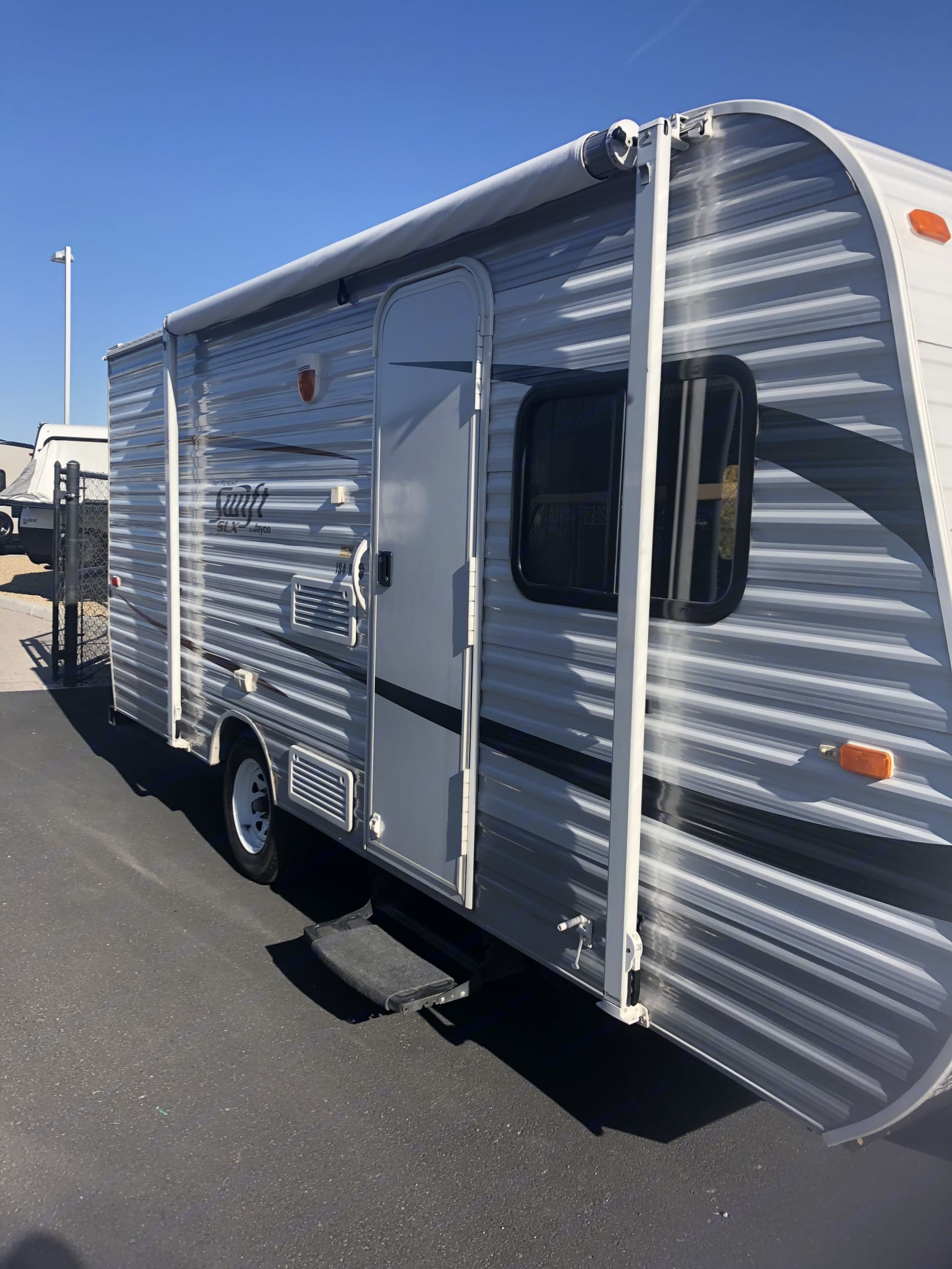 Front door with awning for shade. Jayco Jay Flight Swift 2013