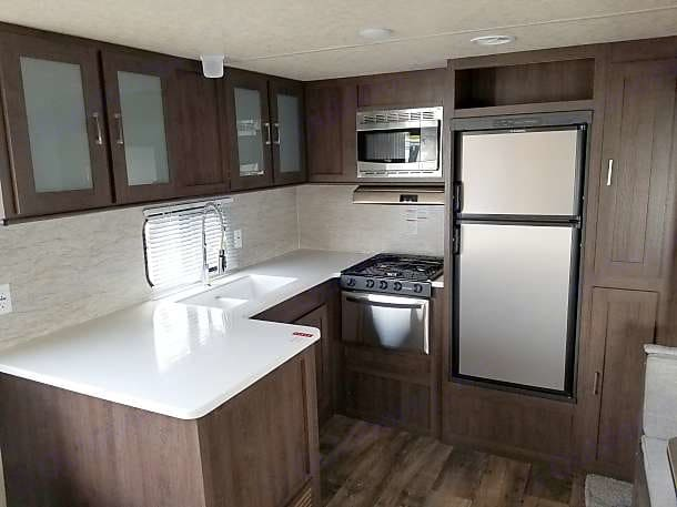 Full spacious kitchen includes dishes and cleaning supplies . Forest River Salem 2018