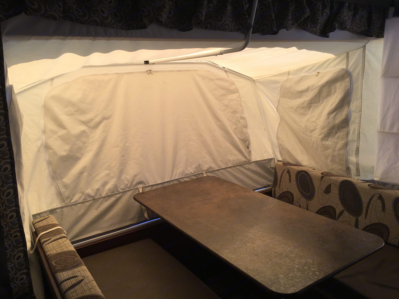 Kitchen Table Side Out - Interior. Forest River Rockwood Premier 2015