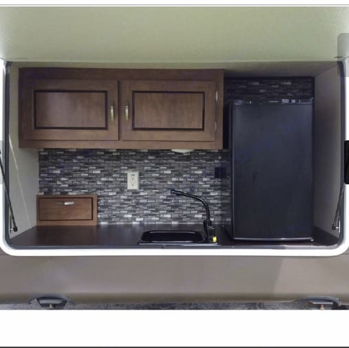Outdoor kitchen with propane grill attached. Wildwood 32qbss Other 2018
