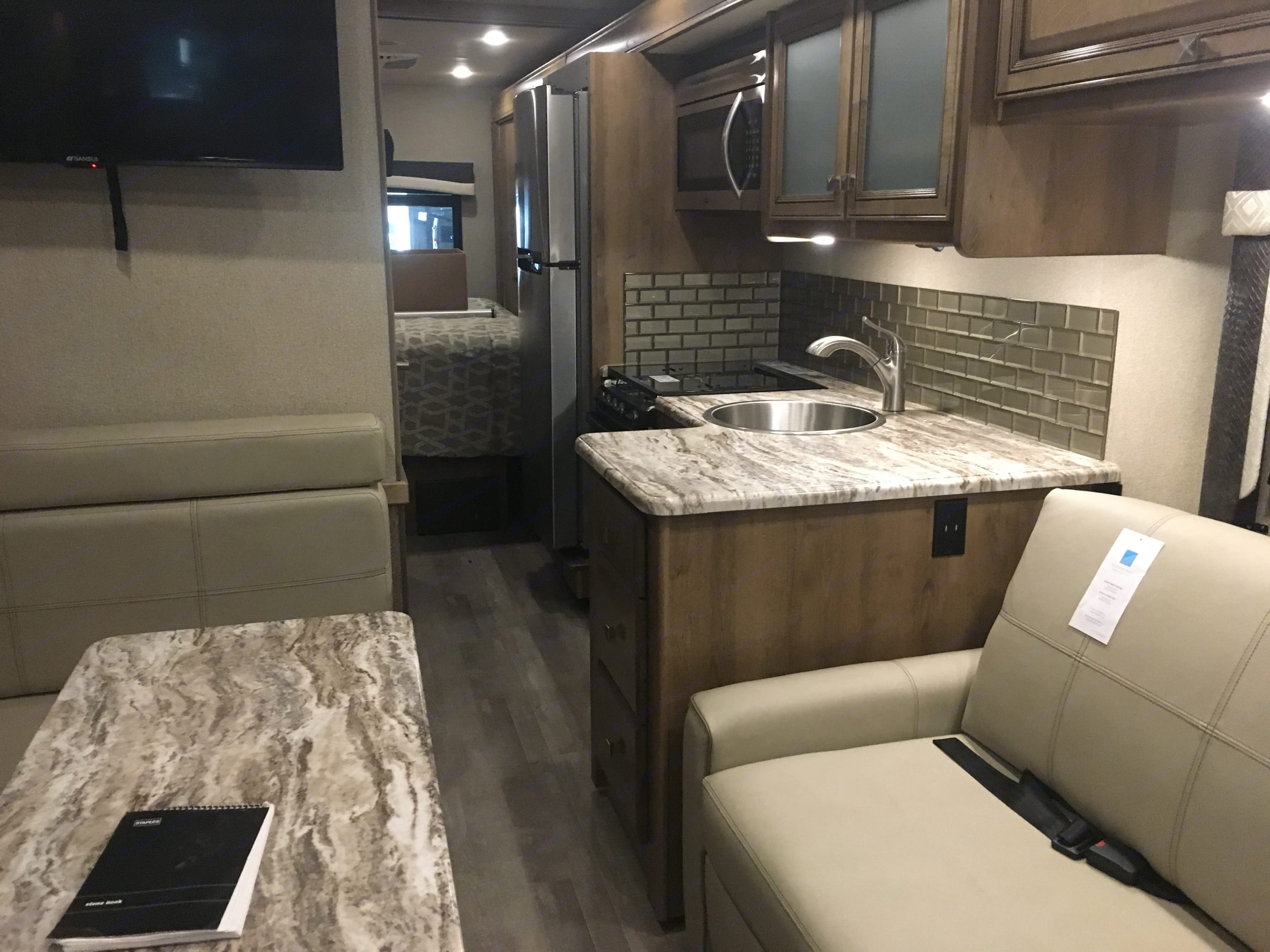 Interior living space with the slide out in. Plenty of room to move around in while driving.. Fleetwood Flair 2019